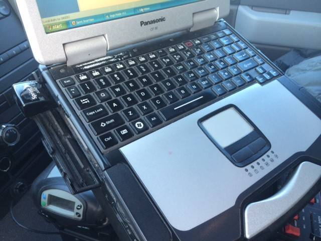 The consumer-grade USB Internet card on the left of the laptop is what Carpentersville's IT department is looking to replace on police and fire department laptops with mobile gateways.