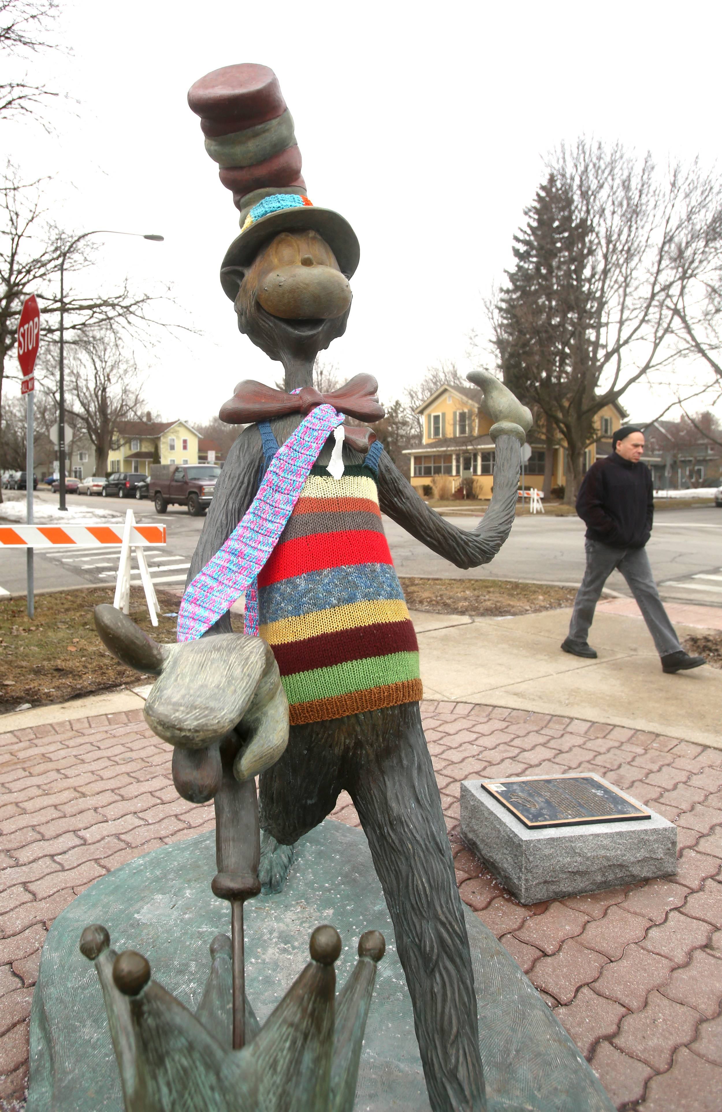 "The Cat in the Hat is cozy in a scarf and sweater as he stands outside Nichols Library in downtown Naperville. The sculpture is one of about 15 installed by the nonprofit Century Walk Corp that has been ""yarn-bombed"" this winter in a practice the group's chairman Brand Bobosky called ""nice and cheerful."""