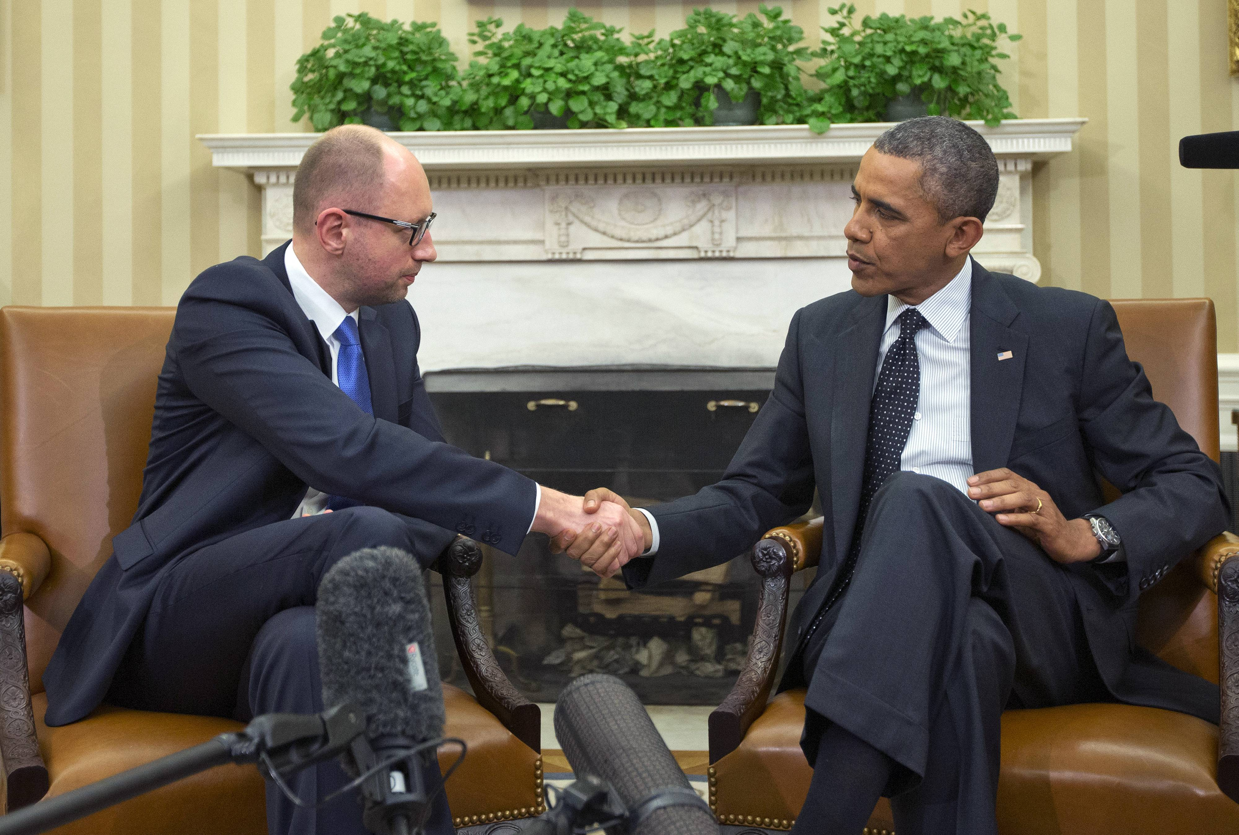 President Barack Obama, right, and Ukraine Prime Minister Arseniy Yatsenyuk, left, met at the White House Wednesday. Obama sought to highlight ties with the former Soviet republic now caught in a diplomatic battle between East and West.