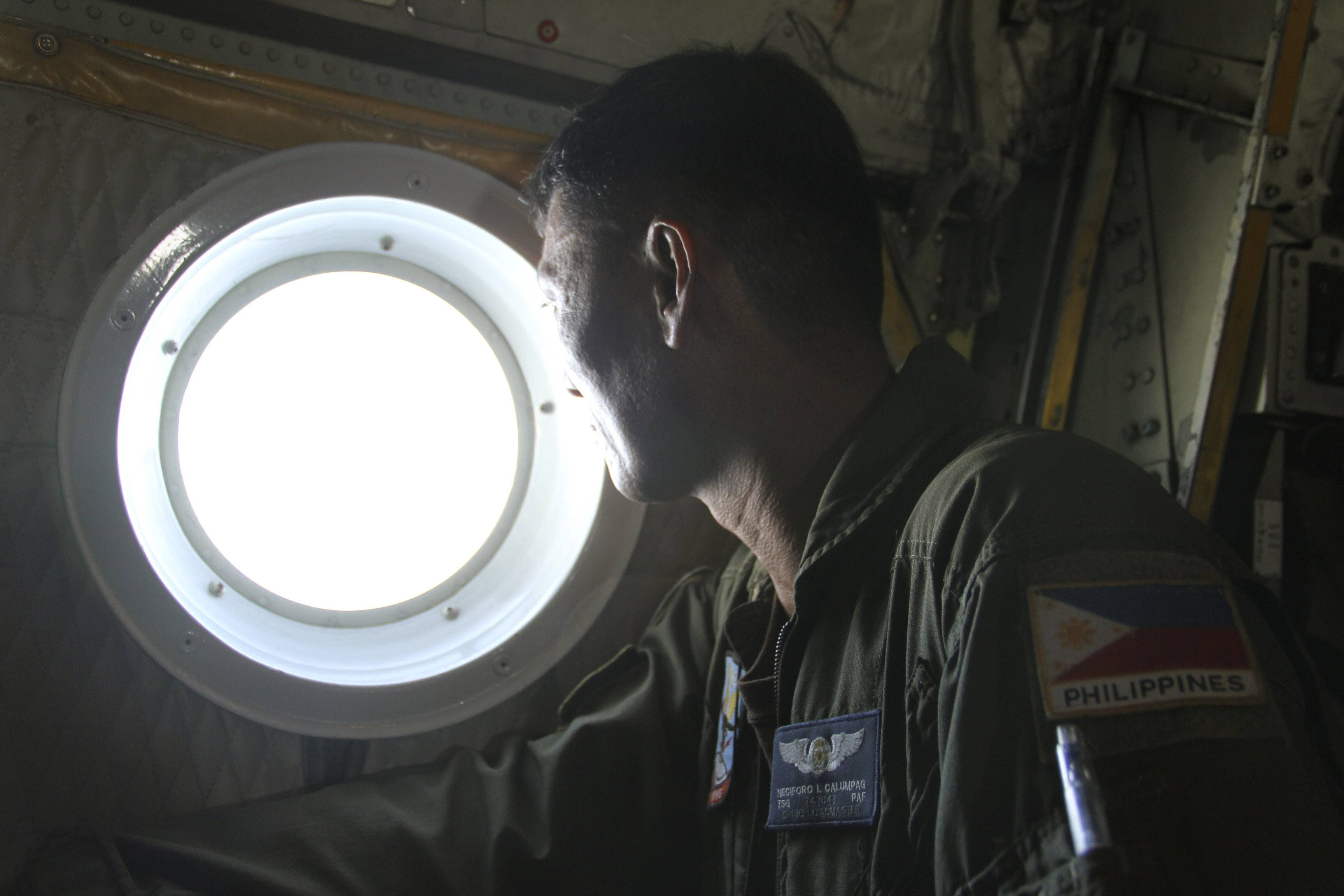 Philippine Air Force C-130 crew members continue their search and rescue mission over the South China Sea more than four days after a Malaysia Airlines jetliner went missing en route to Beijing. Authorities acknowledged Wednesday they didn't know which direction the plane carrying 239 passengers was heading when it disappeared, vastly complicating efforts to find it.