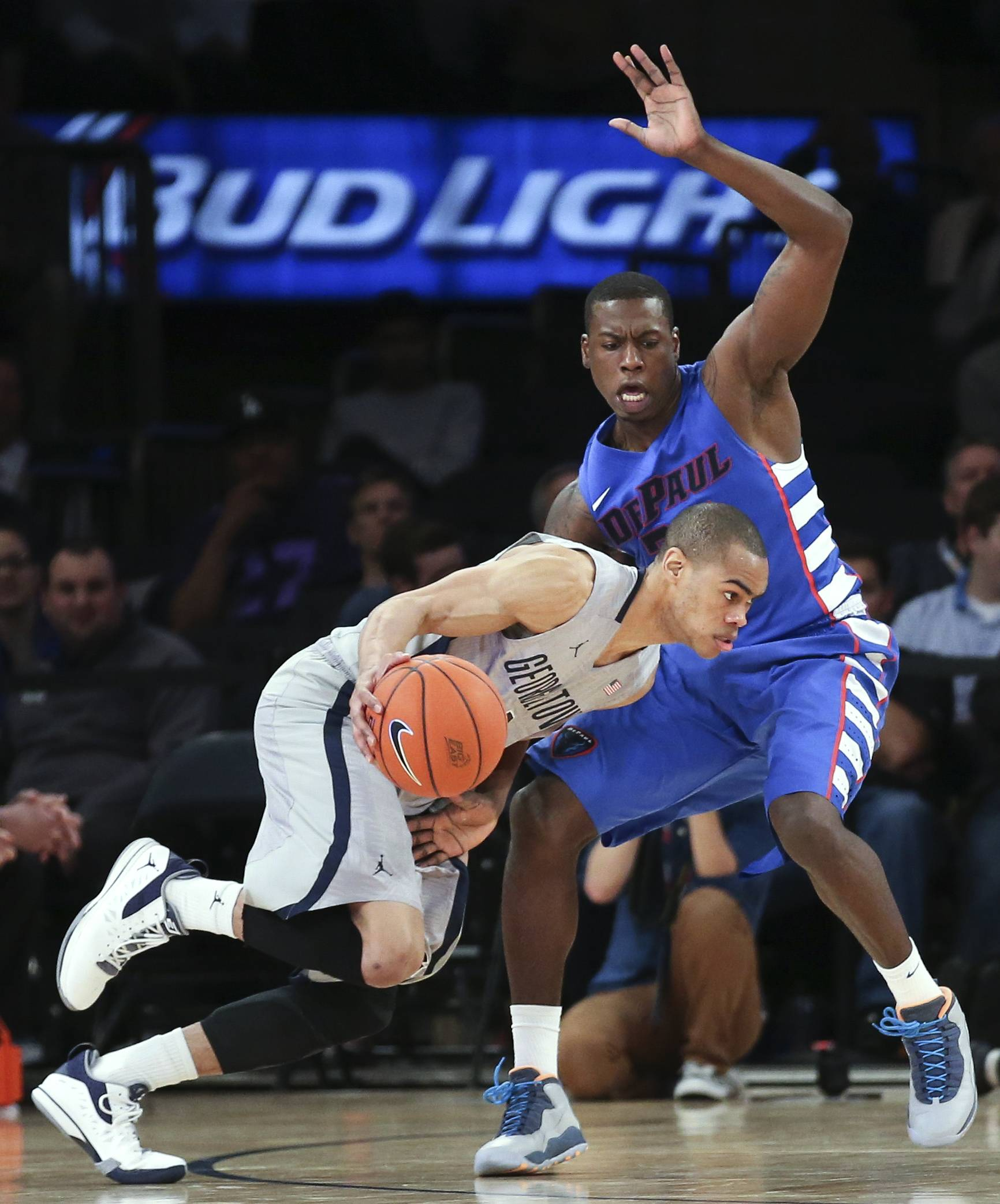 Georgetown guard Markel Starks drives past DePaul guard Charles McKinney during the second half of a Big East tournament game Wednesday at Madison Square Garden.