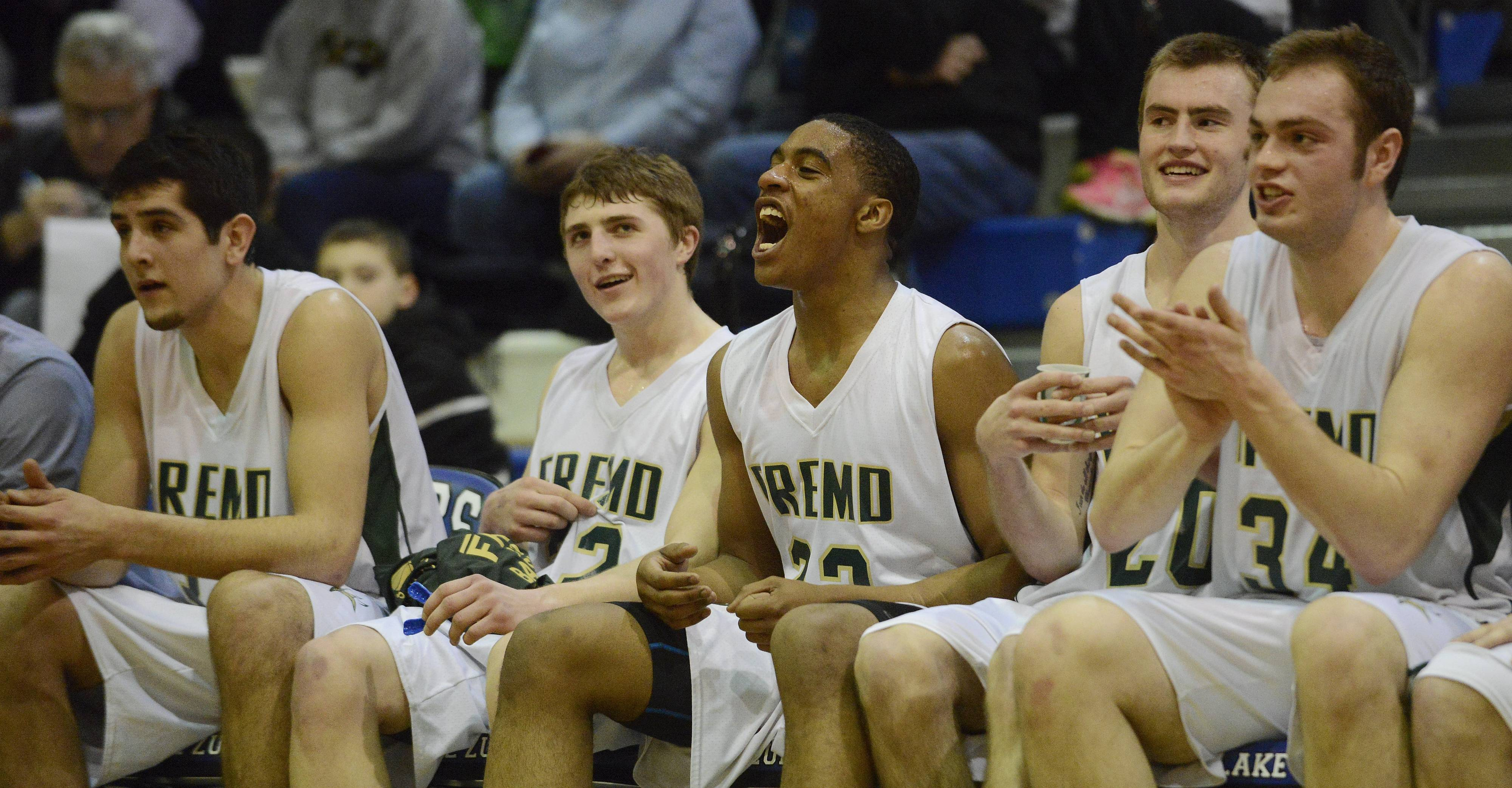 From left, Fremd starters including Matt Ochoa, Garrett Groot, Xavier Williams, Riley Glassmann and Ben Carlson cheer after a basket near the end of during Wednesday's Class 4A sectional semifinal victory over Highland Park at Lake Zurich.