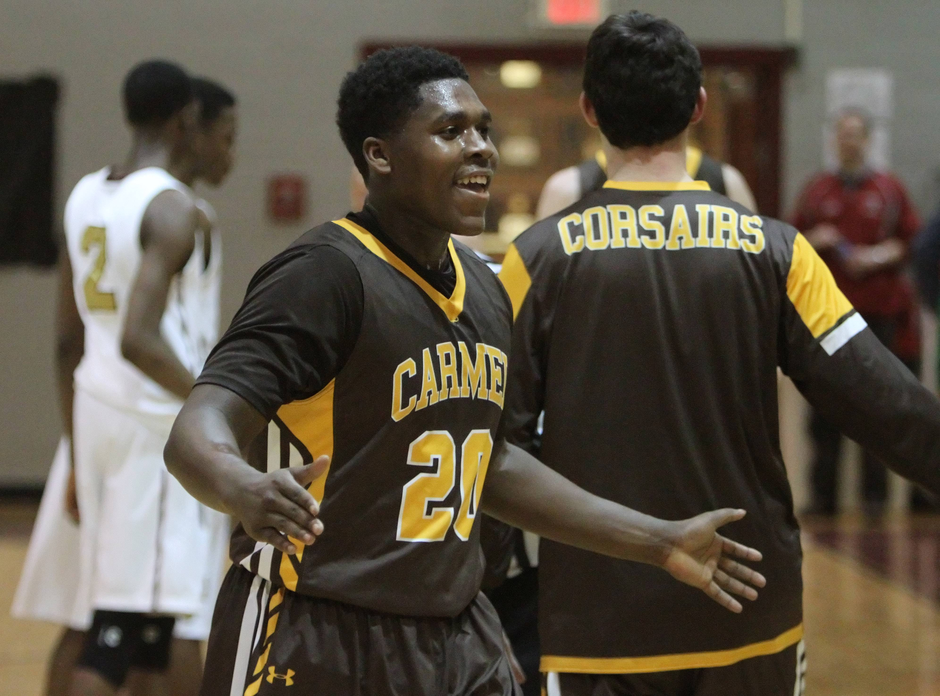 Carmel's Nickai Poyser celebrates.