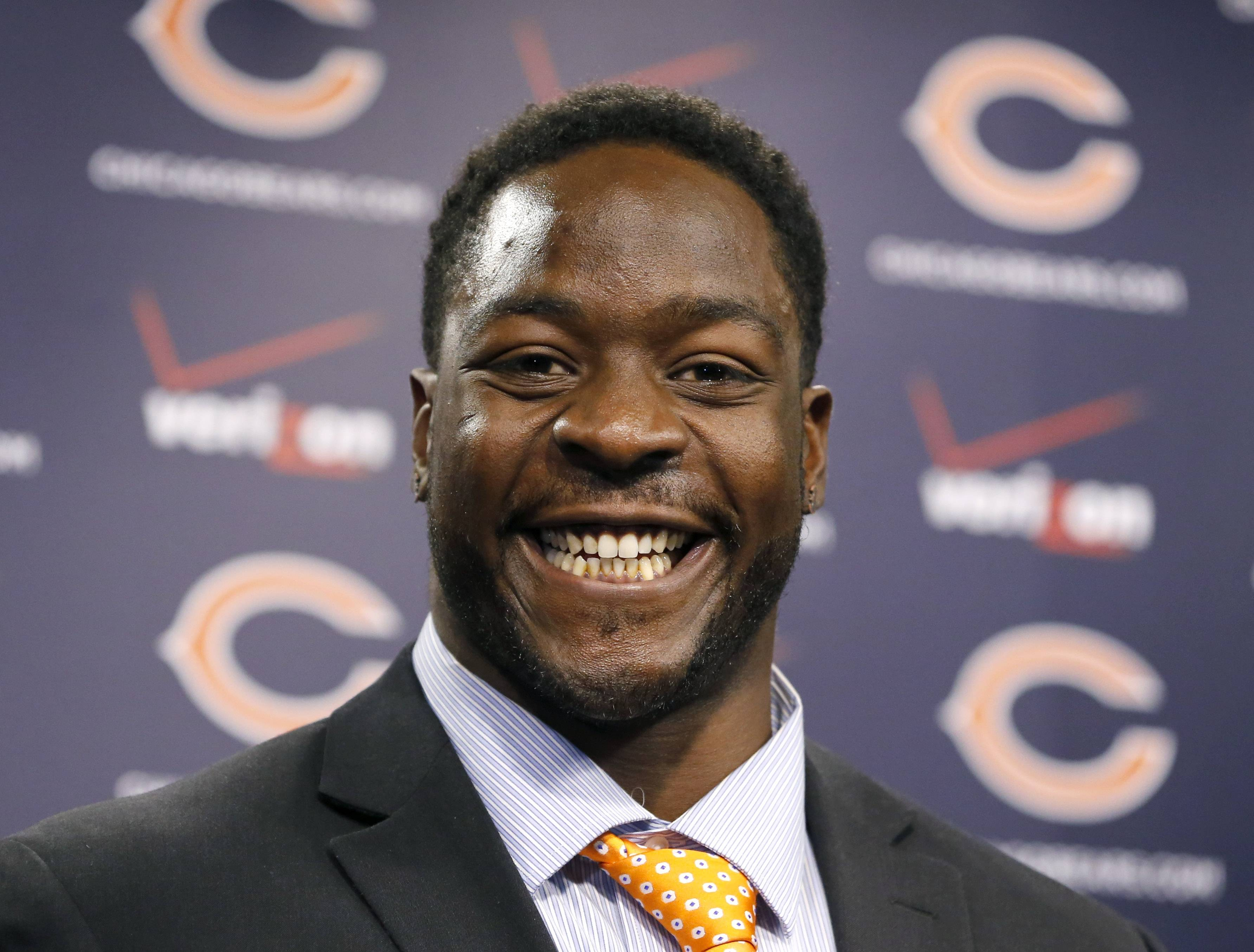 Bears defensive end Lamarr Houston smiles after being introduced as the newest member of the team during a news conference Wednesday, March 12, 2014, in Lake Forest, ill.