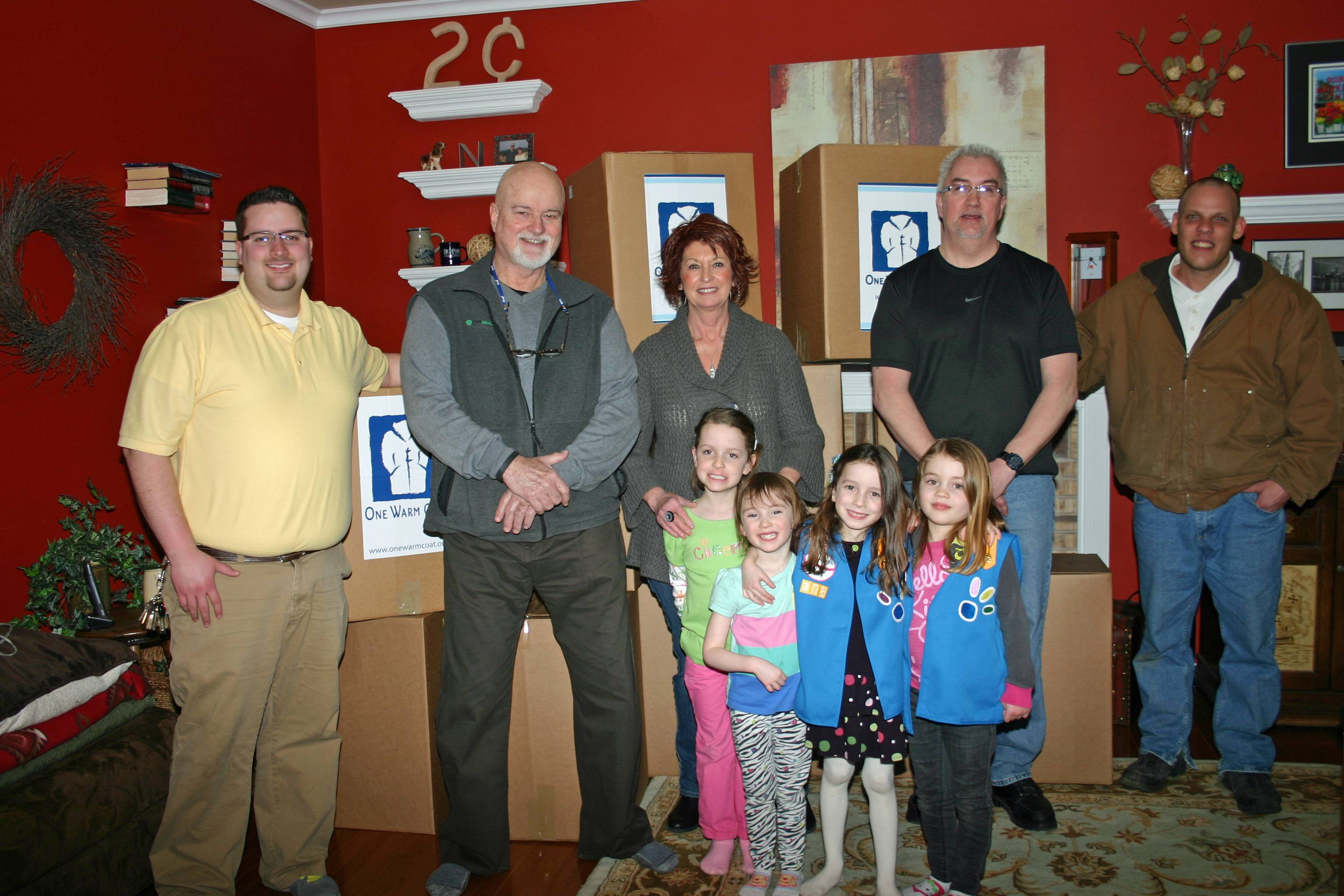 With over 500 coats donated to Wayside Cross Ministries, Pro Energy Consultants smashed their coat donation record this year. Pictured with a few of the coat boxes, from left to right are Kale Little, Hope Outreach Coordinator of Wayside Cross Ministries; Jerry Needham, Pro Energy Consultants; Billie Needham, Pro Energy Consultants; Mike Clancy and Gabriel Murray, both residents within the Master�s Touch program of Wayside Cross Ministries. In the front, left to right are Emma Spinney, Bella Bruno, Marianna Bruno and Jade McCrink, members of Daisy Scout Troop 373 and Daisy Scout Troop 1154 out of Grace McWayne Elementary School, Batavia.
