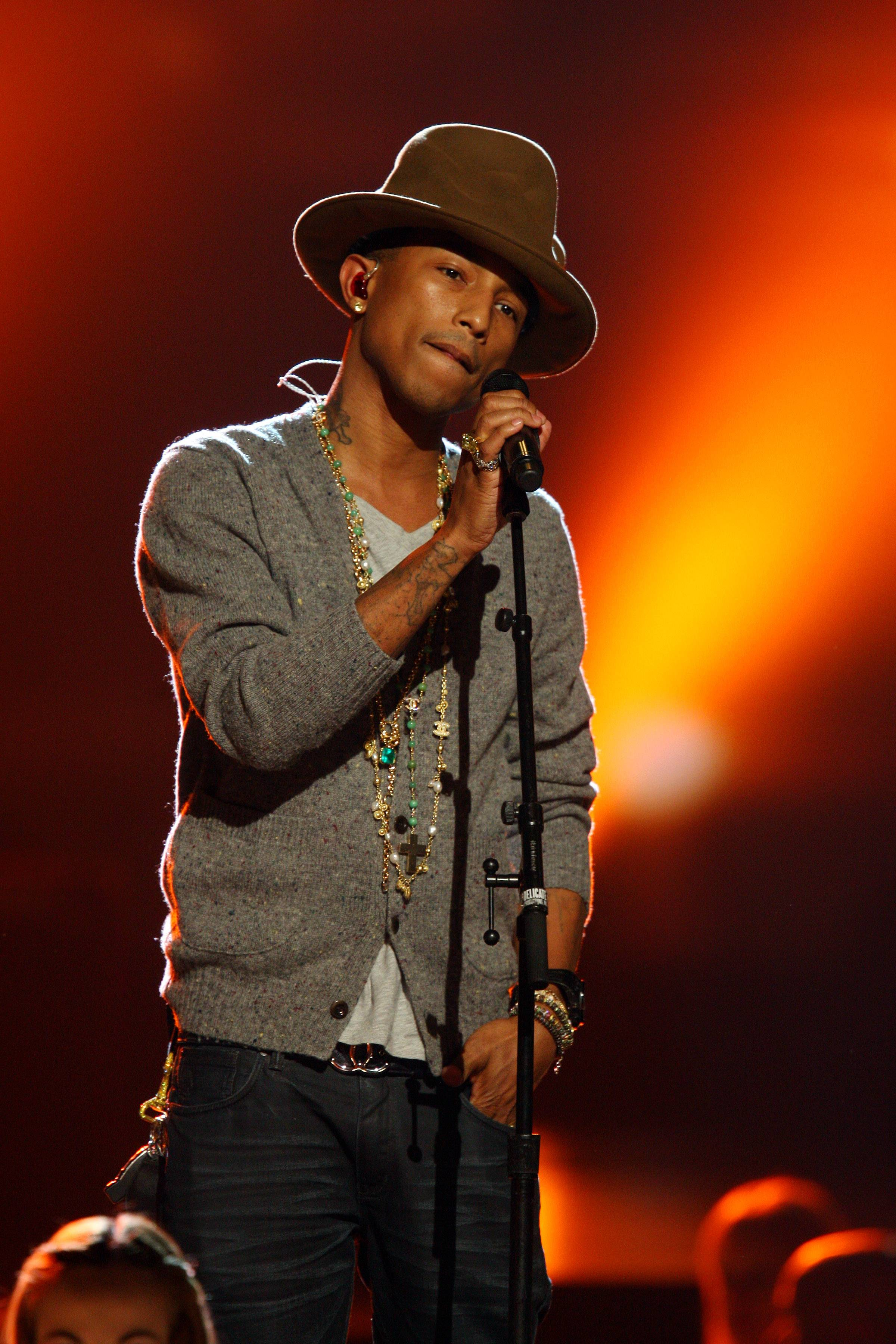 "Pharrell Williams, seen here performing at The Night that Changed America: A Grammy Salute to the Beatles, just released his sophomore solo album, ""G I R L,"" which features the Oscar-nominated hit, ""Happy."""