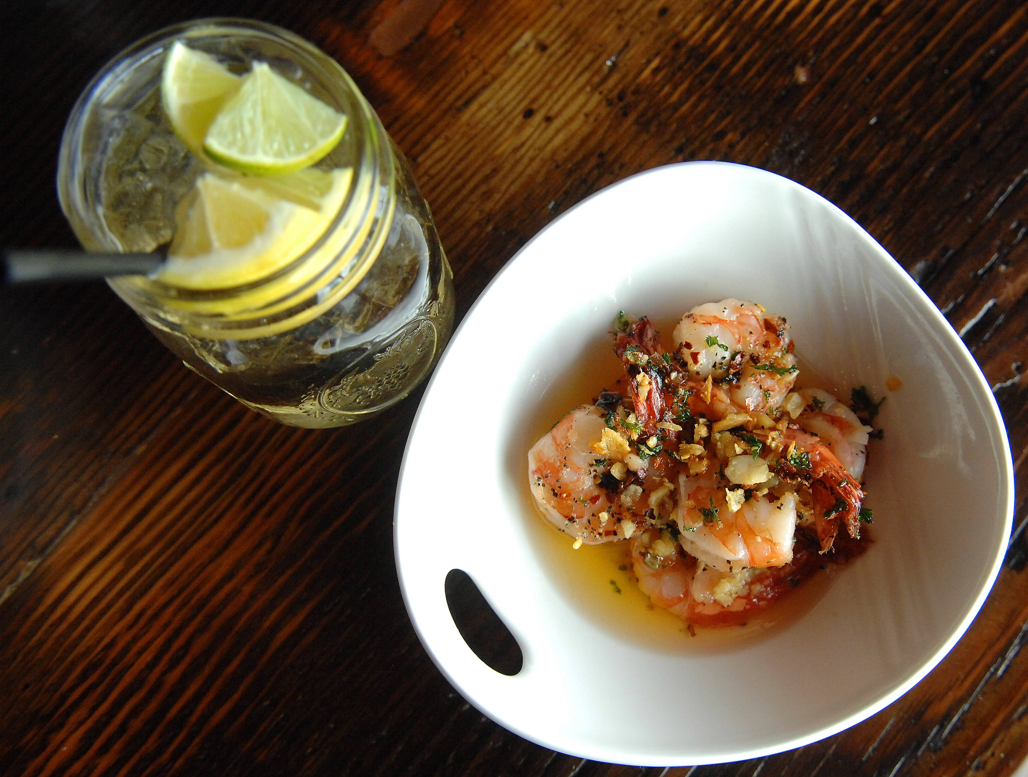 Gambas al Ajillo, or garlic shrimp, pairs well with white wine sangria at Macarena Tapas in St. Charles.