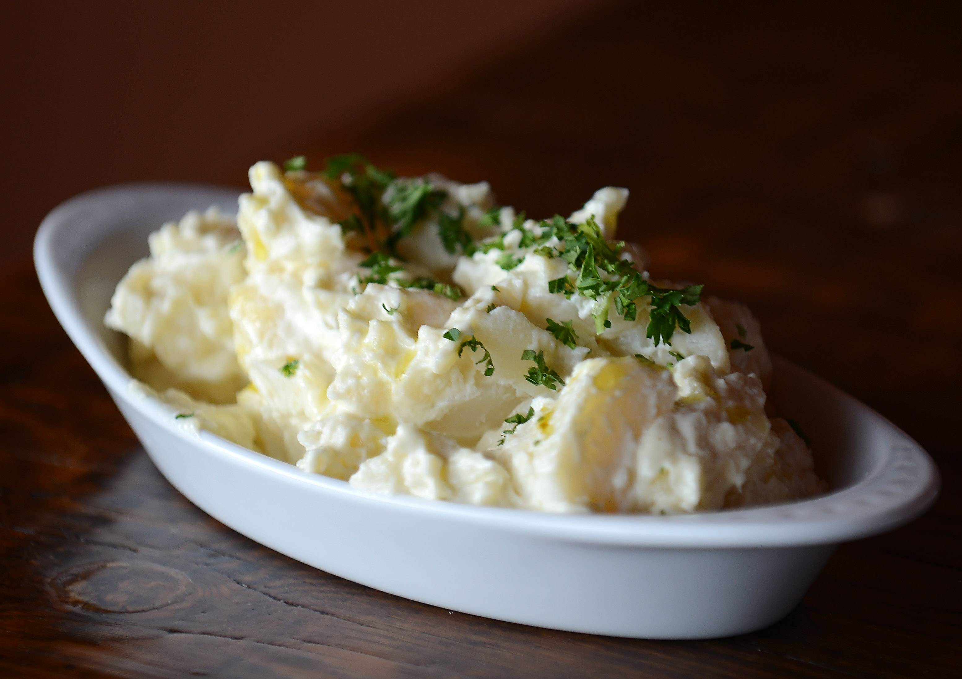 Patatas Alioli, or garlic potato salad, is one of the many small-plate options available at Macarena Tapas in St. Charles.