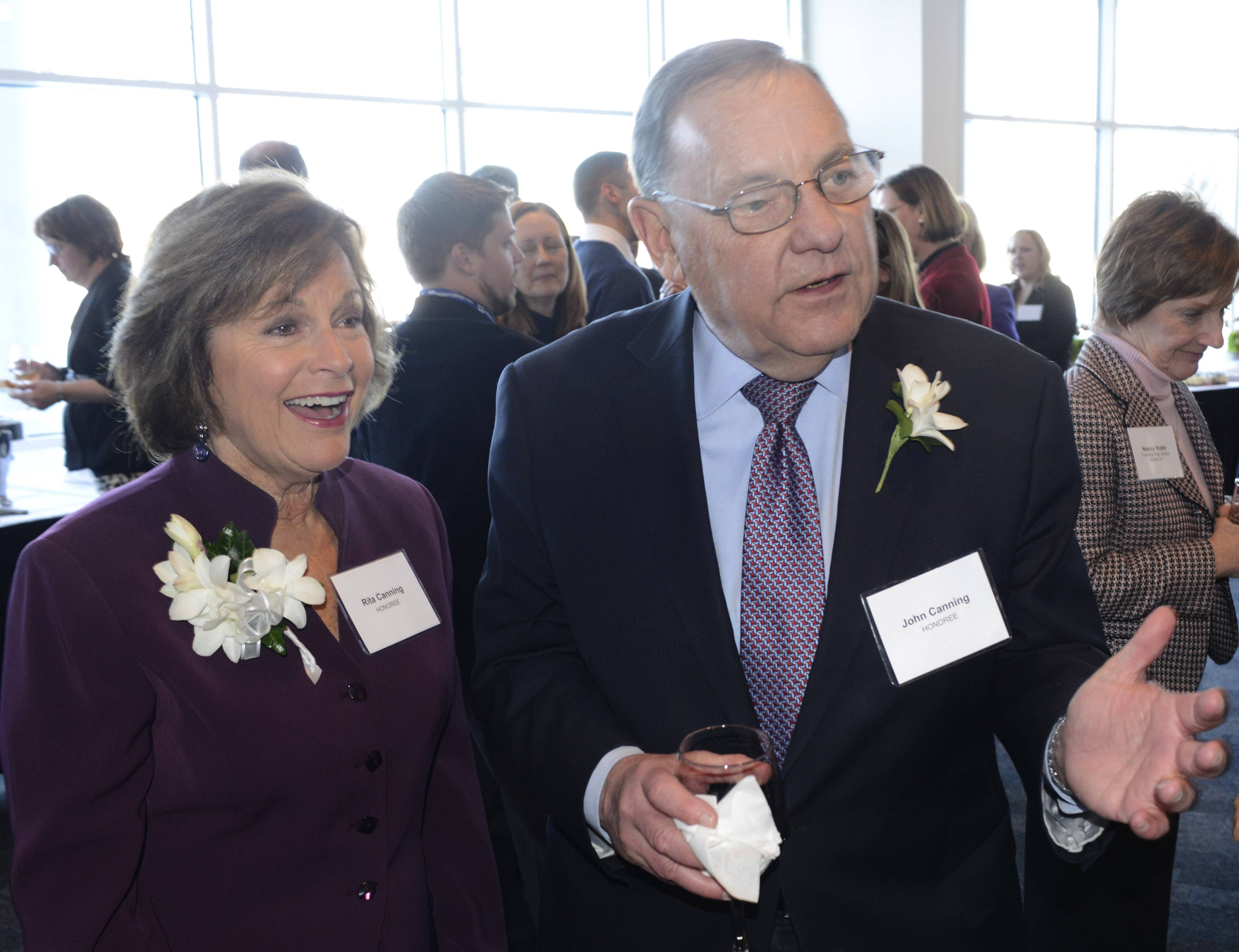 "Rita and John Canning of Inverness greet guests during a reception before the announcement of the couple's $1 million gift to Harper College in Palatine. The gift will benefit the Rita and John Canning women's Program., which"" provides educational support, resources and the opportunity for a fresh start for single parents, displaced homemakers and others, many of whom are survivors of domestic violence,"" according to a Harper College news release."