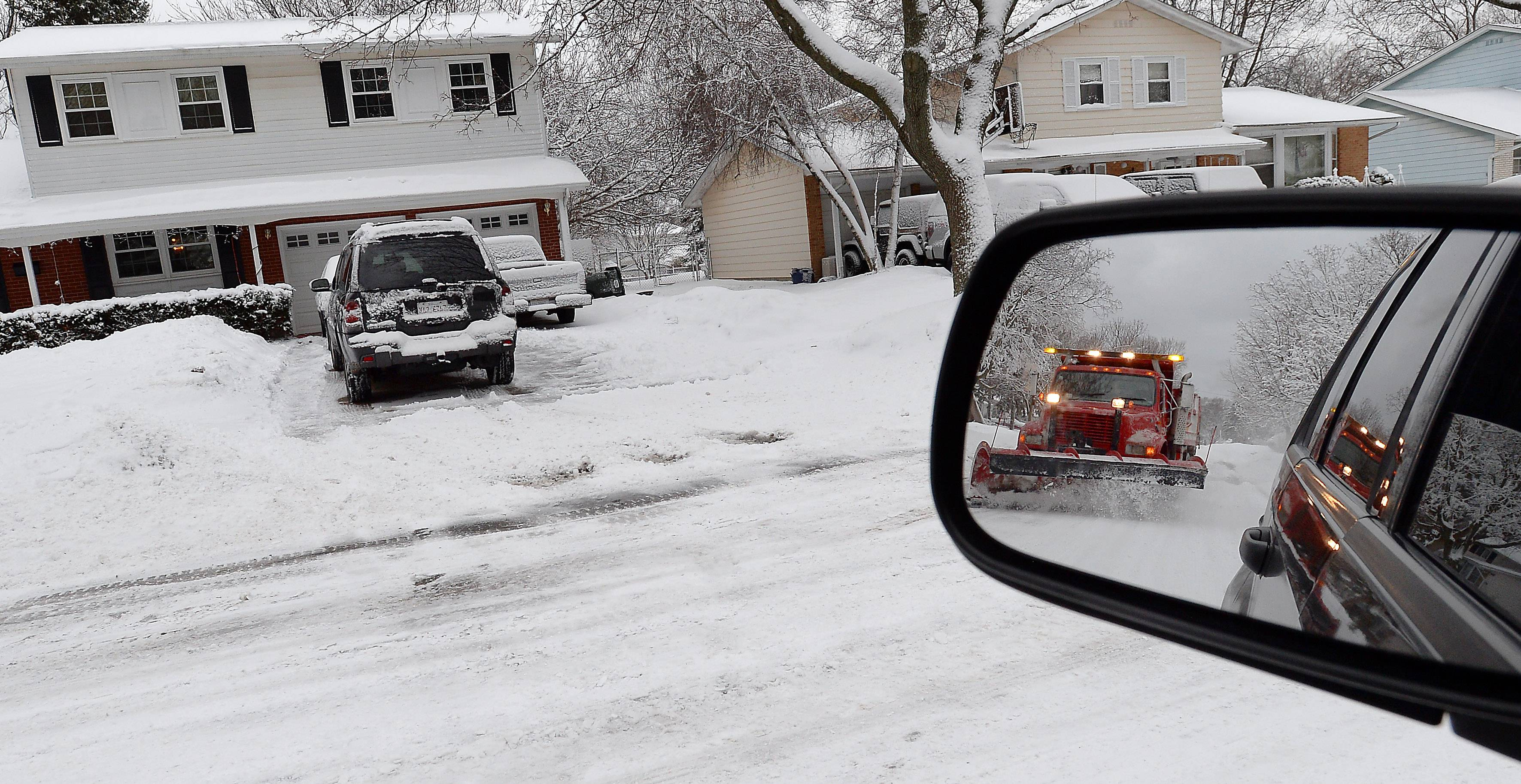 This all too common sight this winter is the snowplow driving through your neighborhood. Today was no exception as another winter blast dumped several inches of snow in the Northwest suburbs around the Palatine area.