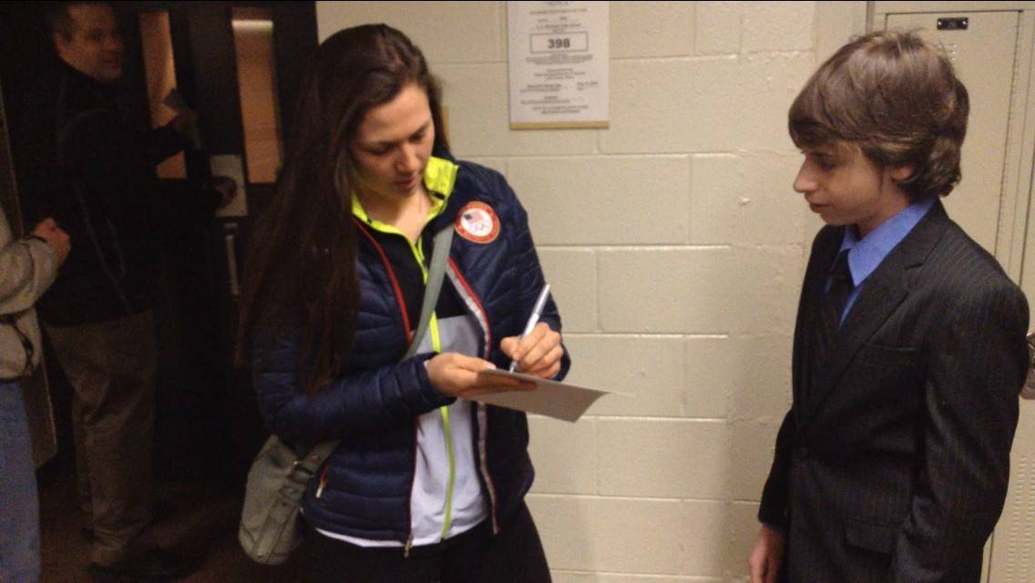 Olympian Megan Bozek, left, signs an autograph Wednesday for Stevenson High School freshman Larry Patlakh.