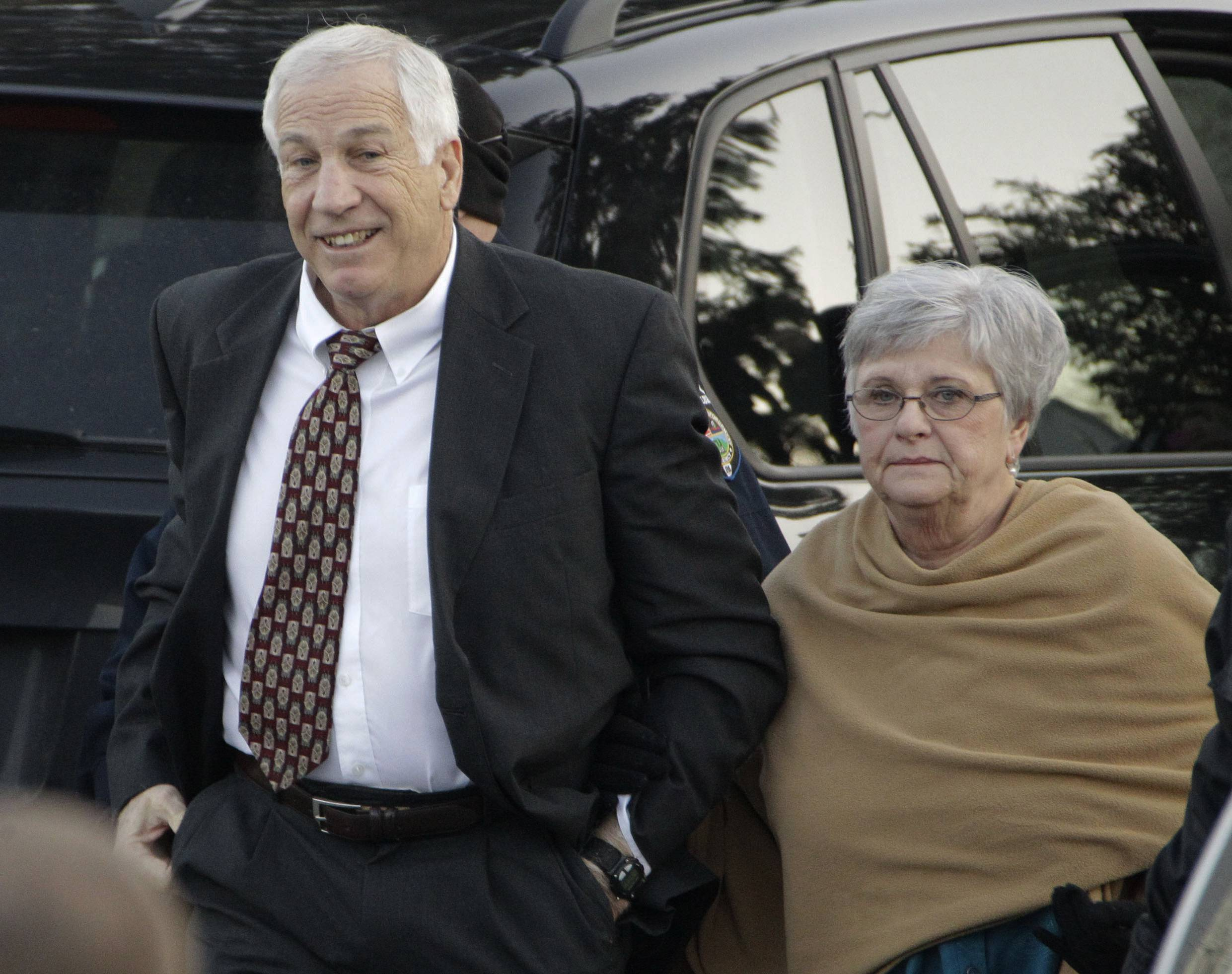 "Former Penn State assistant football coach Jerry Sandusky and his wife, Dottie. In an interview broadcast Wednesday, March 12, 2014 on NBC's ""Today,"" Dottie Sandusky says she ""definitely"" believes her husband is innocent despite his conviction of the sexual abuse of 10 boys. Jerry Sandusky is serving a 30- to 60-year sentence."