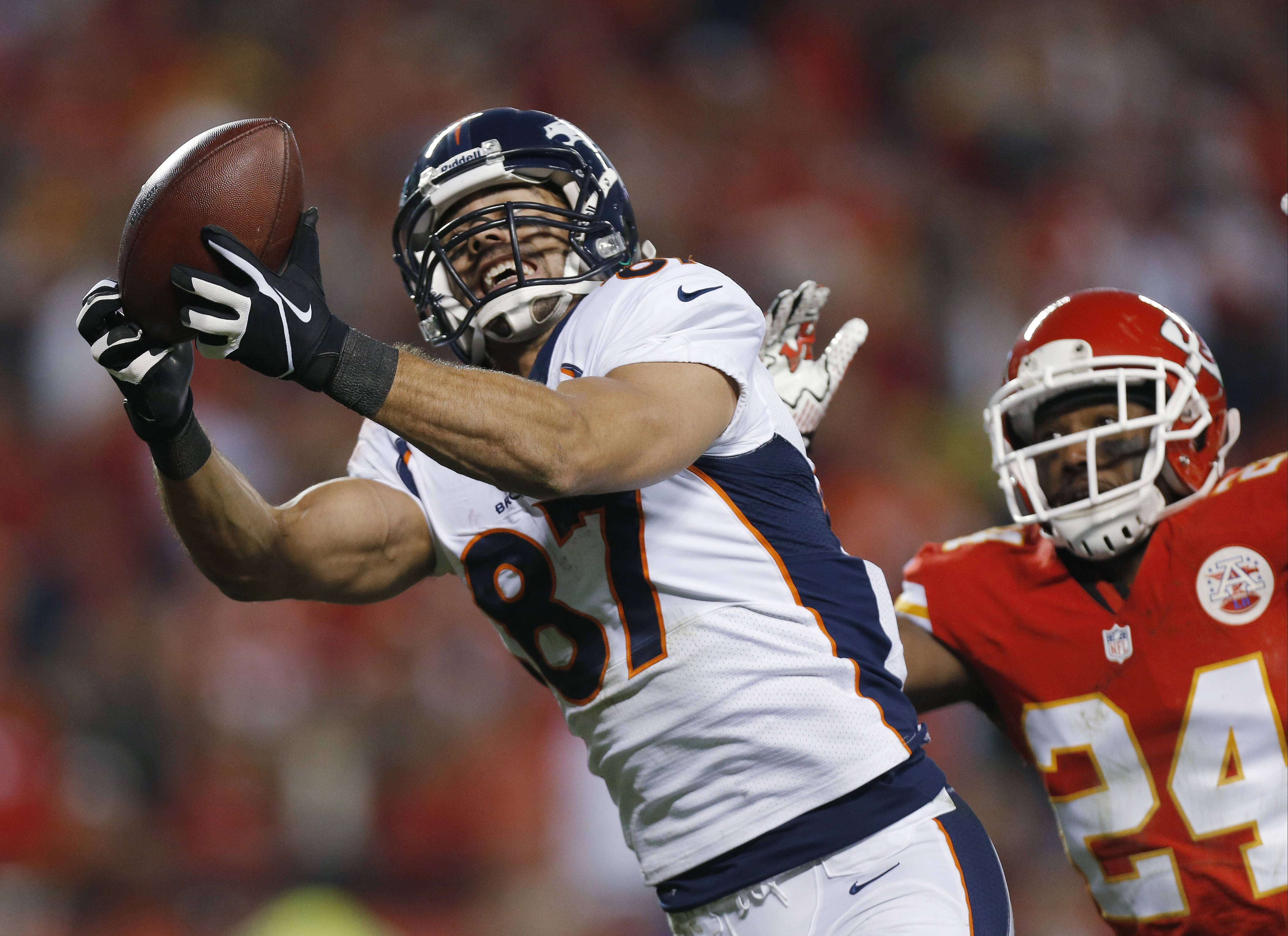 Denver Broncos wide receiver Eric Decker makes a touchdown catch against Kansas City Chiefs cornerback Brandon Flowers during the Dec. 1 game in Kansas City, Mo. Decker set career highs with 87 catches and 1,288 yards receiving to go along with 11 touchdowns last season.