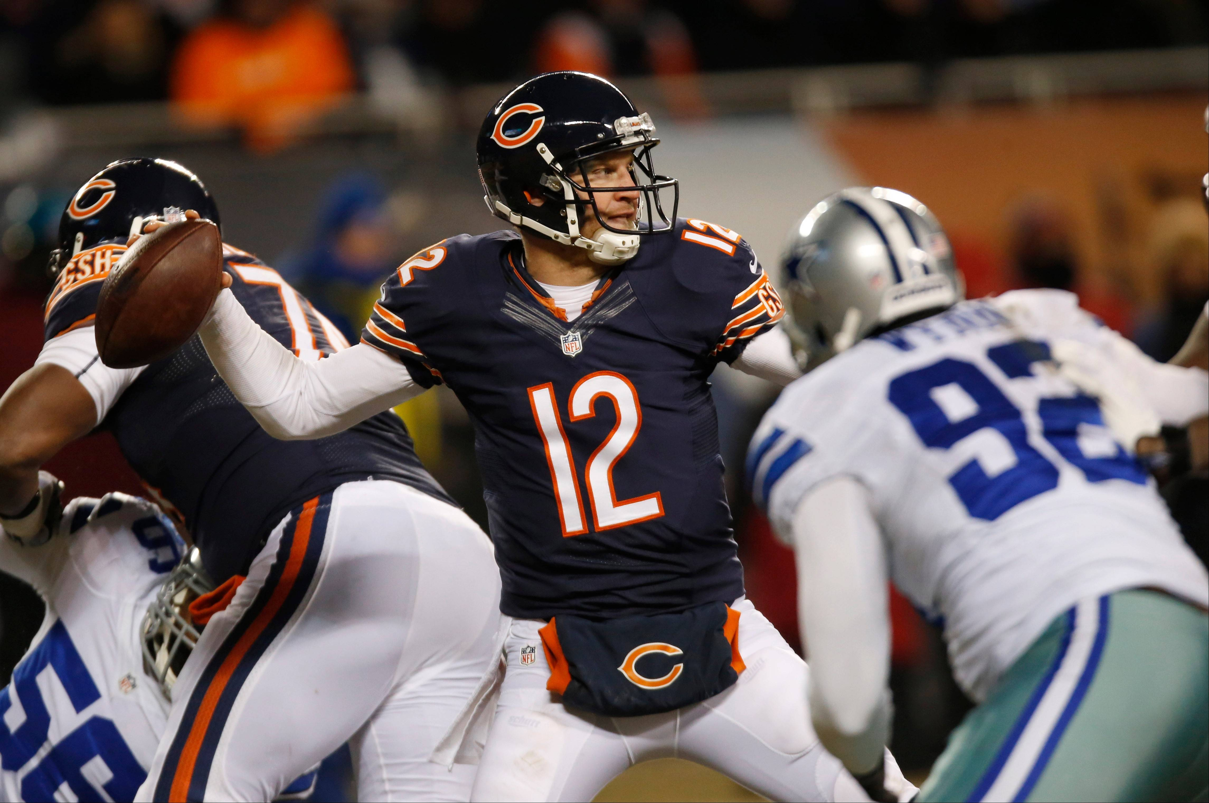 Bears quarterback Josh McCown fires a pass against the Dallas Cowboys last season. McCown is leaving the Bears after signing a two-year deal with Lovie Smith and the Tampa Bay Buccaneers.