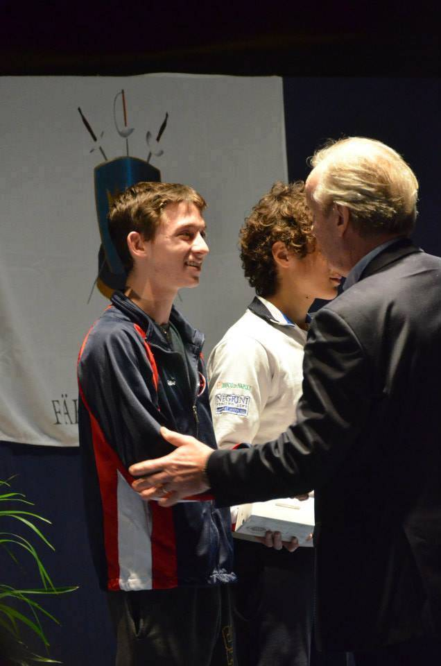 Gabe Weininger receives congratulations for sixth place in the European Fencing Confederation's Cadet Circuit for men's epee in Goteborg, Sweden