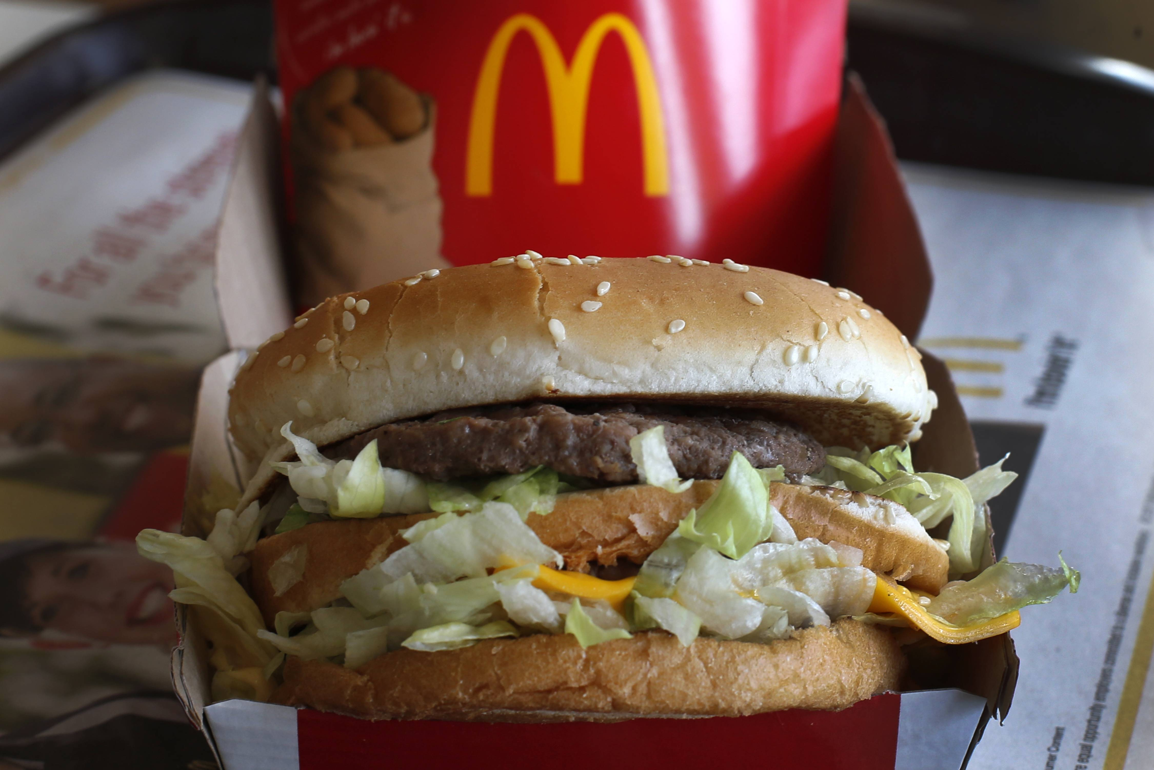 Several lawsuits being filed against McDonald's say the fast-food chain engages in a variety of practices to avoid paying workers what they're owed. A McDonald's Big Mac sandwich is seen here.