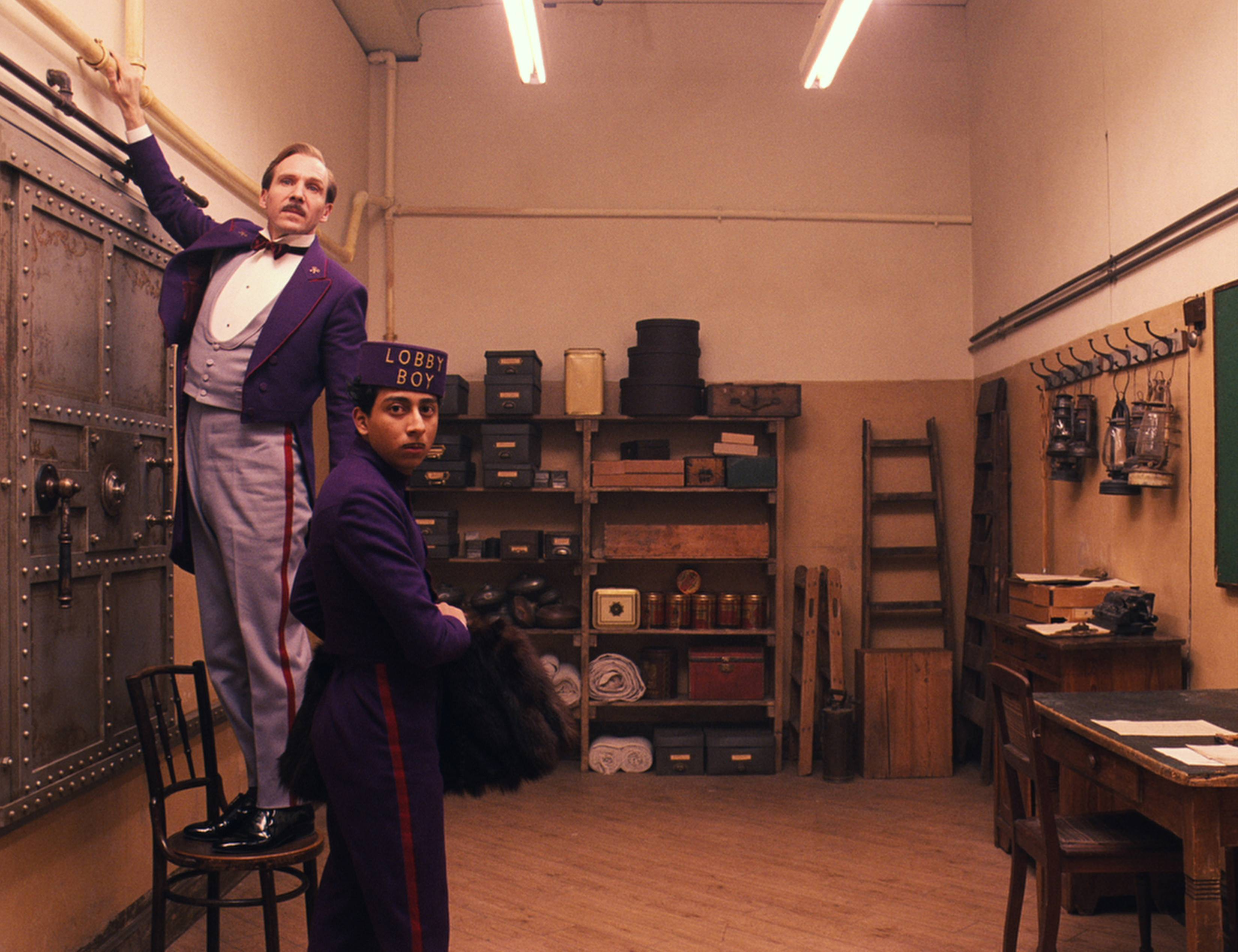 "Gustave (Ralph Fiennes, left) introduces Zero (Tony Revolori) to the world of ""The Grand Budapest Hotel."""