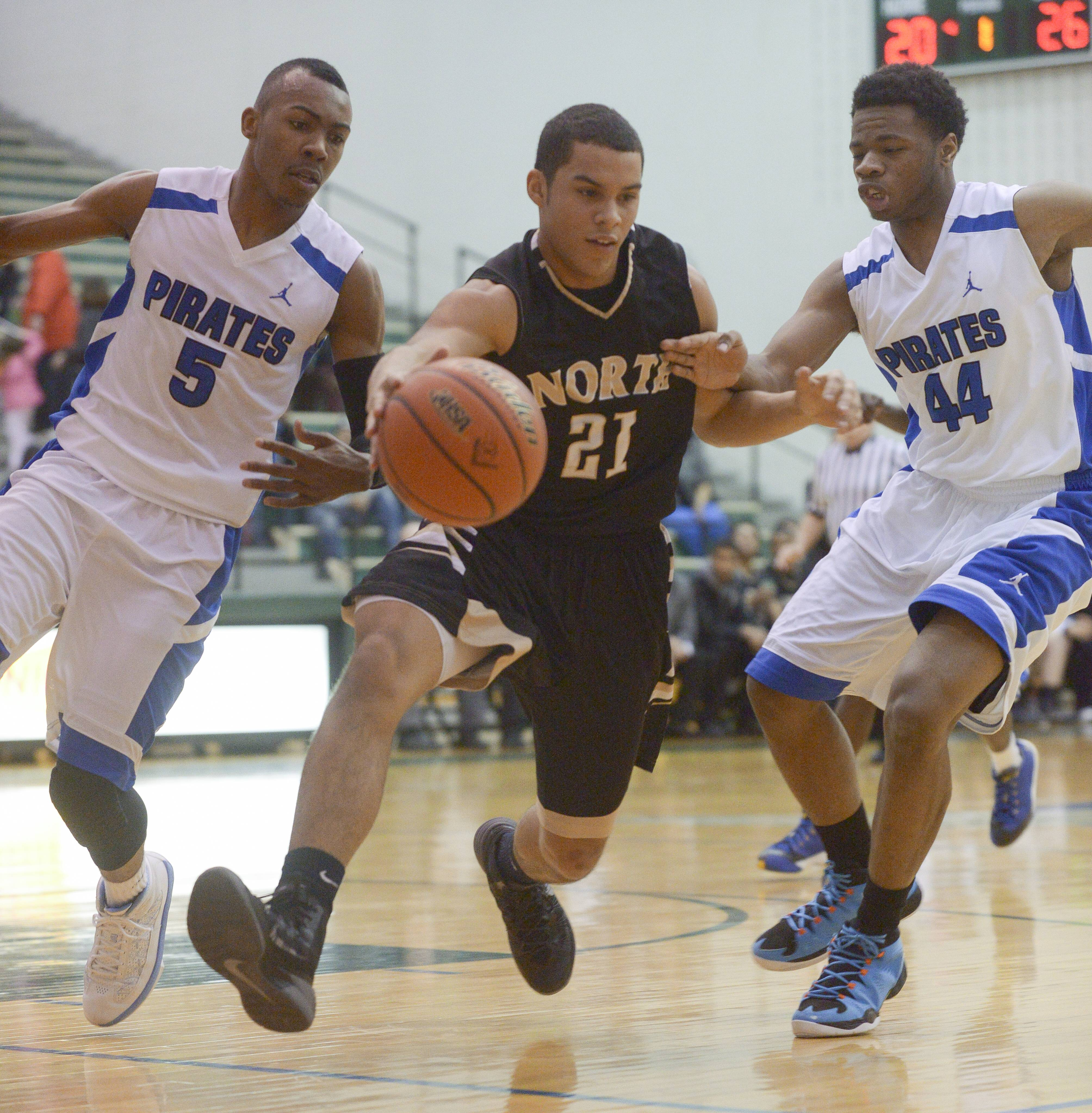 Glenbard North's Kendall Holbert drives the ball through Proviso East's Jevon Carter and Josh Smith during the Bartlett 4A sectional semifinal, Wednesday.