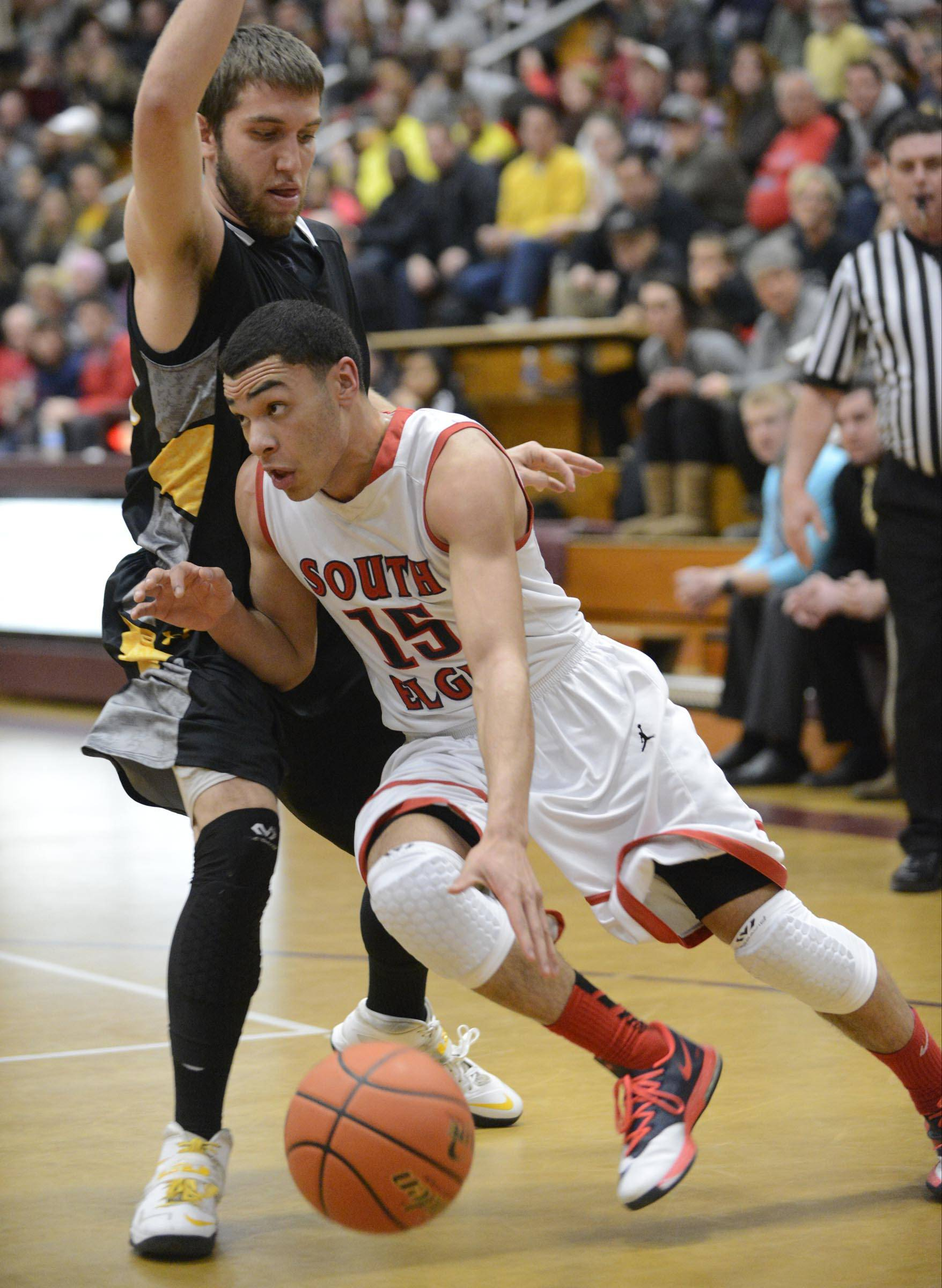 South Elgin senior Matt Smith (15) drives to the basket during the Storm's 71-66 Class 4A sectional semifinal win over Jacobs Wednesday at Elgin's Chesbrough Field House. South Elgin takes on Rockford Auburn Friday in the sectional championship game.