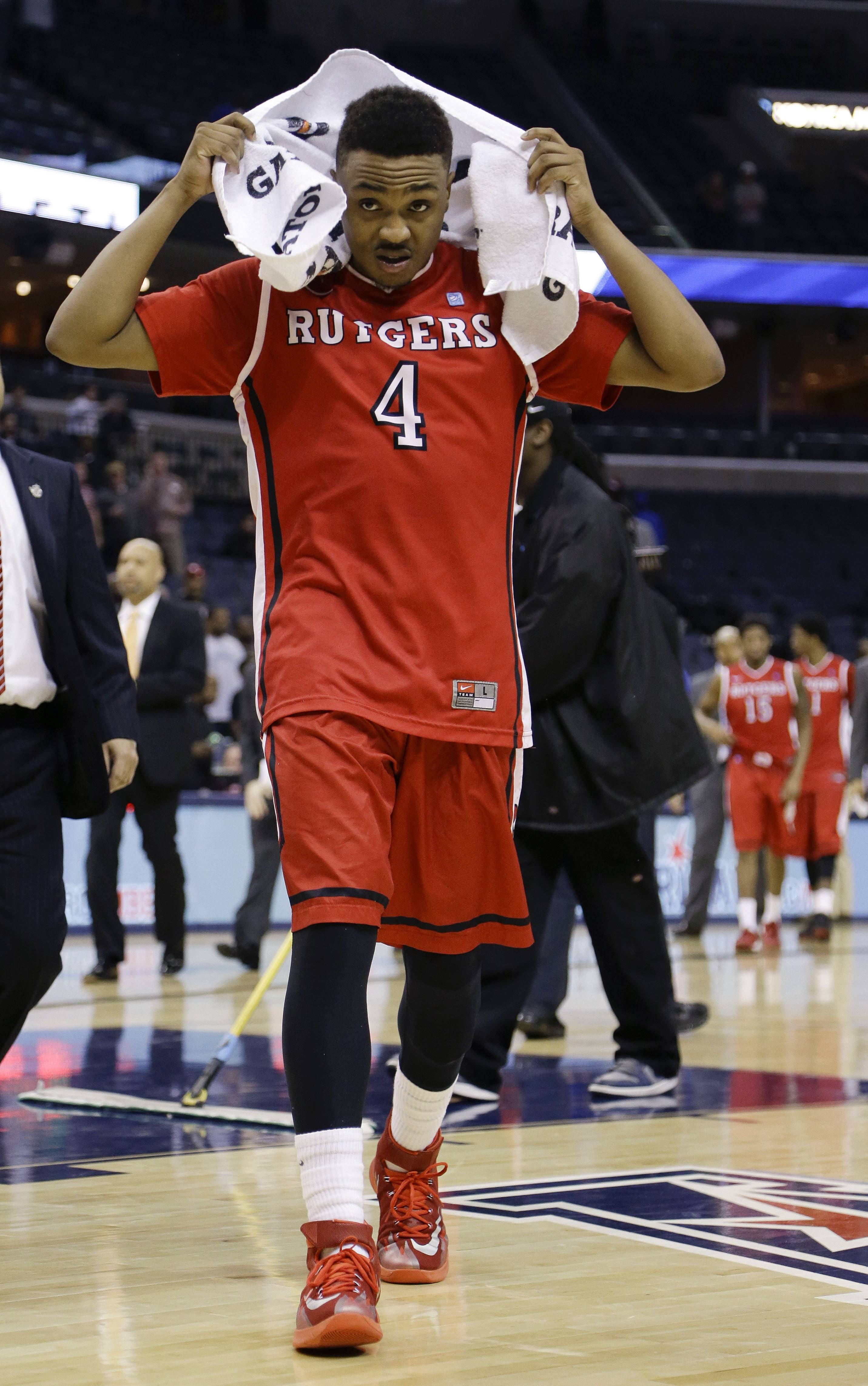 Rutgers guard Myles Mack (4) leaves the court after his team's 92-31 loss to Louisville in an NCAA college basketball game in the quarterfinals of the American Athletic Conference tournament Thursday, March 13, 2014, in Memphis, Tenn. (AP Photo/Mark Humphrey)