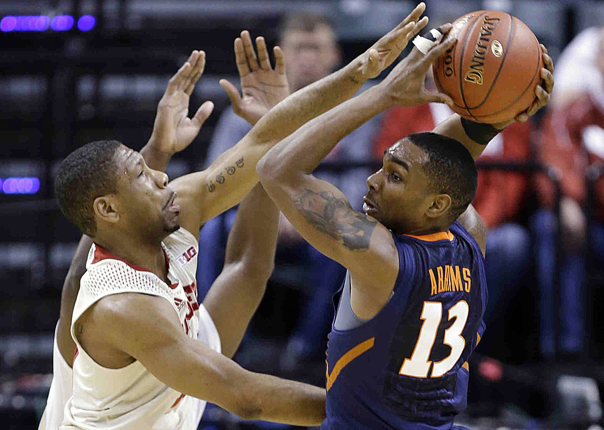 Illinois guard Tracy Abrams looks to pass against Indiana's Evan Gordon Thursday during the first half in the first round of the Big Ten tournament in Indianapolis.