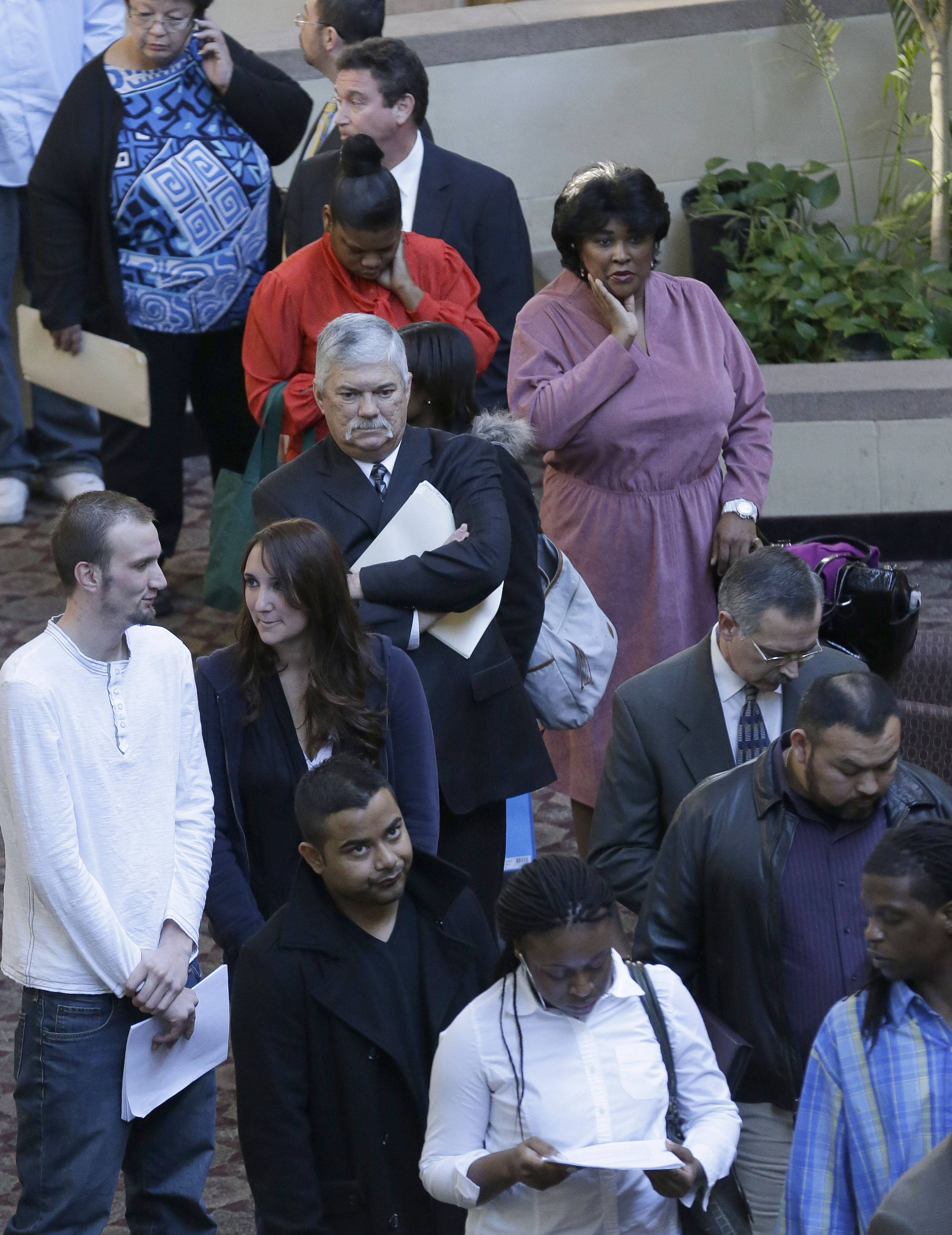 Job seekers line up to meet prospective employers at a career fair at a hotel in Dallas.