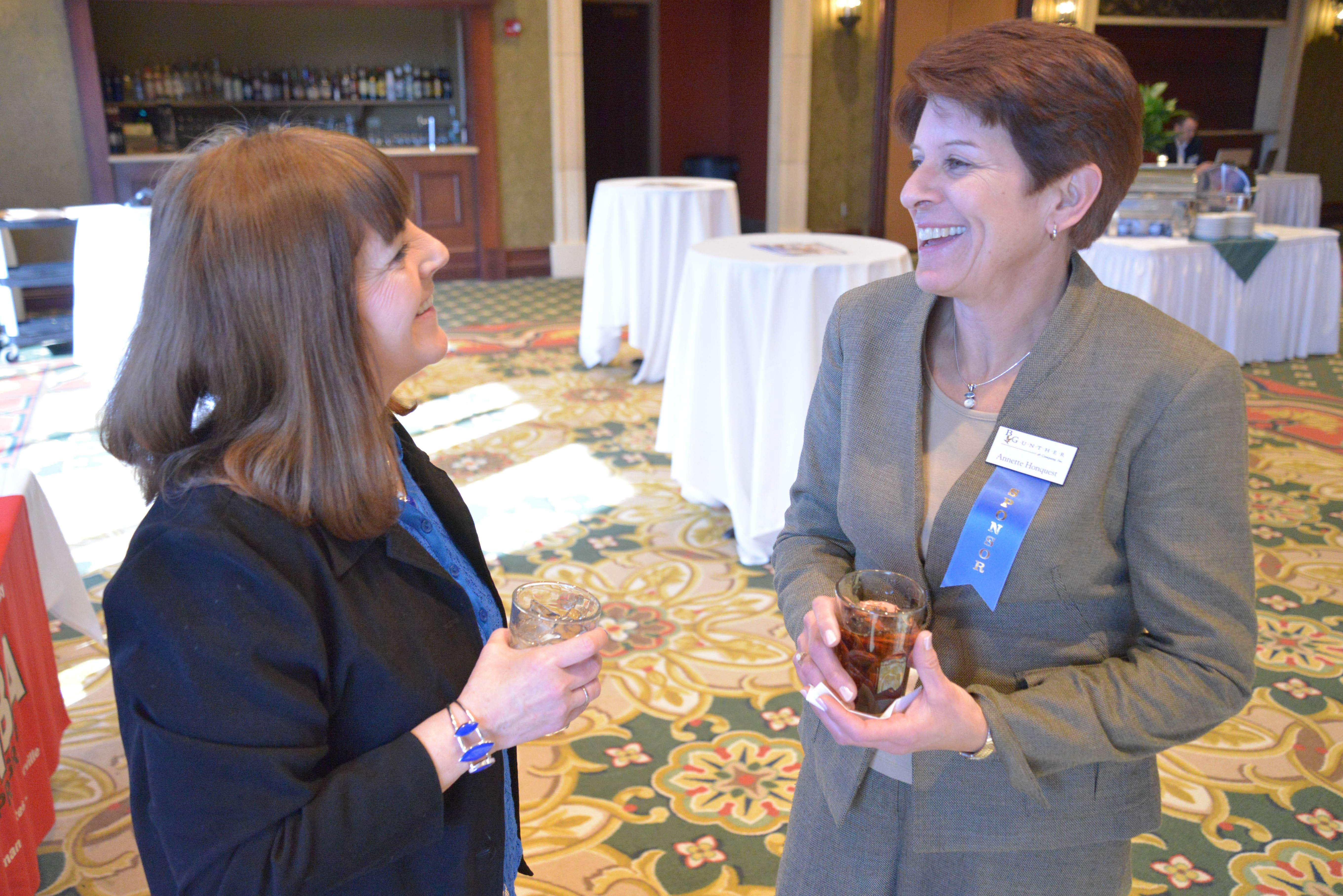 Fran Oleksy, left, and Annette Honquest of B Gunther chat during the Daily Herald Business Ledger AABE event at Medinah Banquets in Addison.