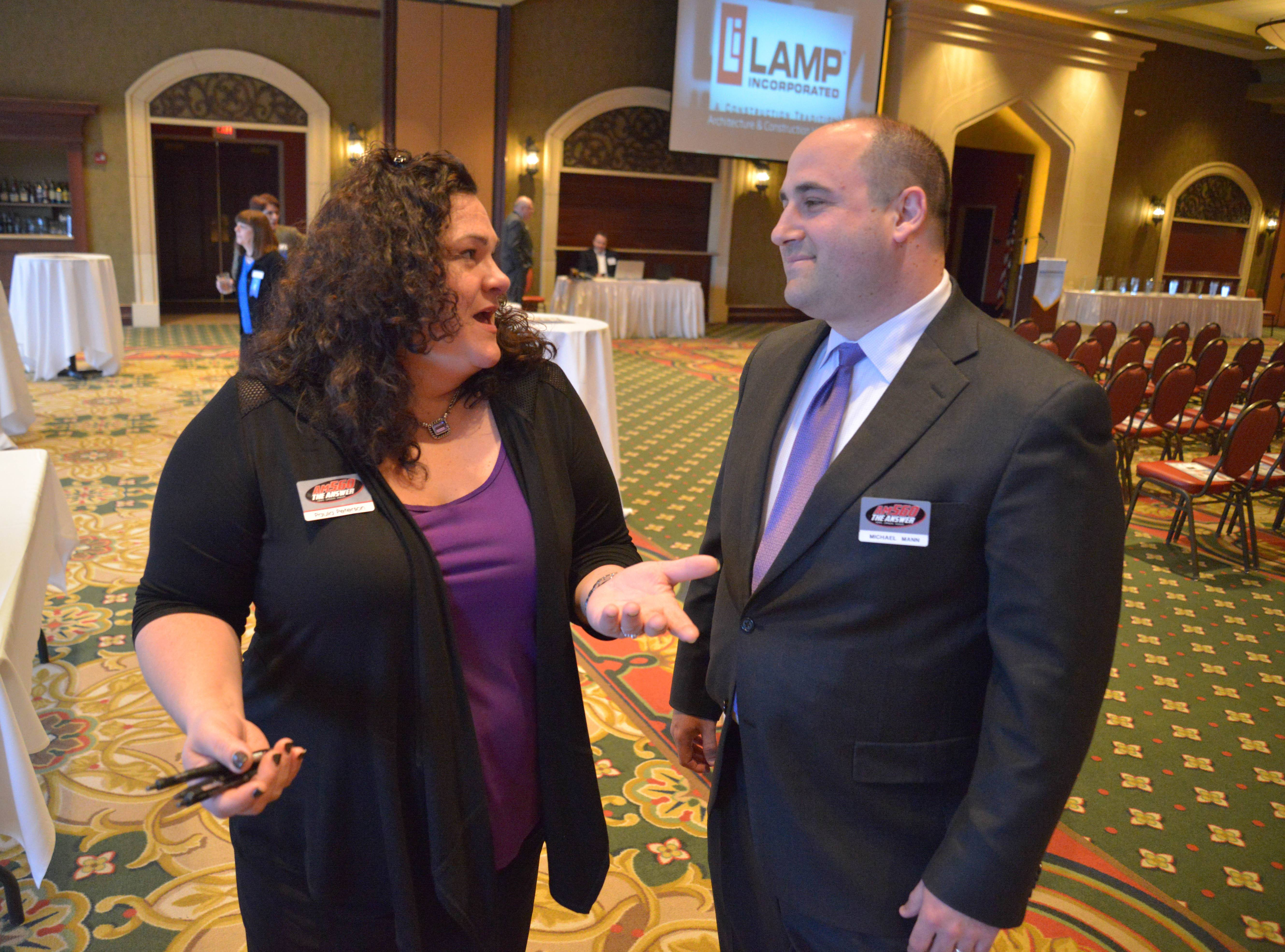 Paula Peterson and Michael Mann of AM 560 The Answer chat during the Daily Herald Business Ledger AABE awards in Addison.