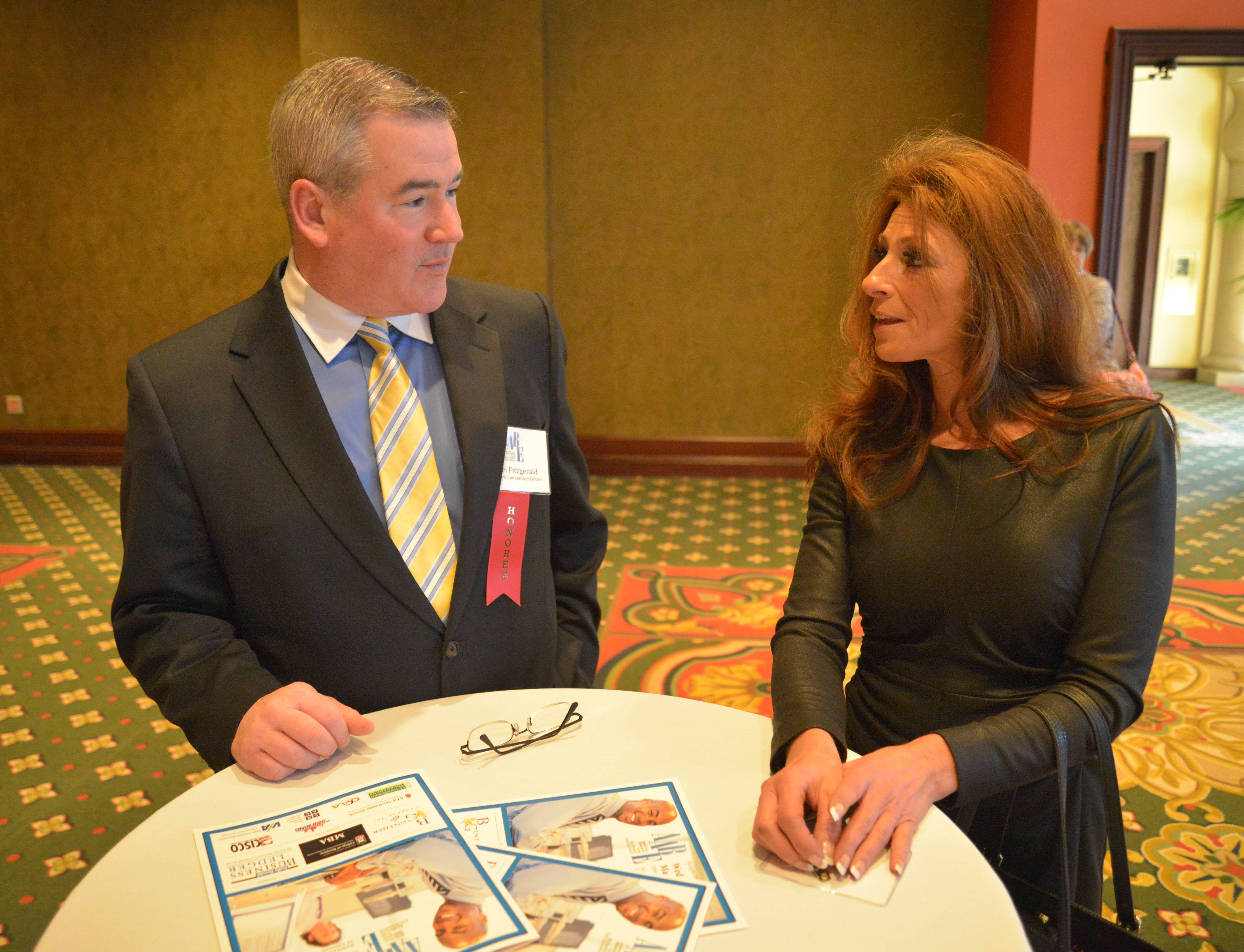 Daniel Fitzgerald and Kari Stramaglia of the Tinley Park Convention Center chat during the Daily Herald Business Ledger AABE awards Wednesday.