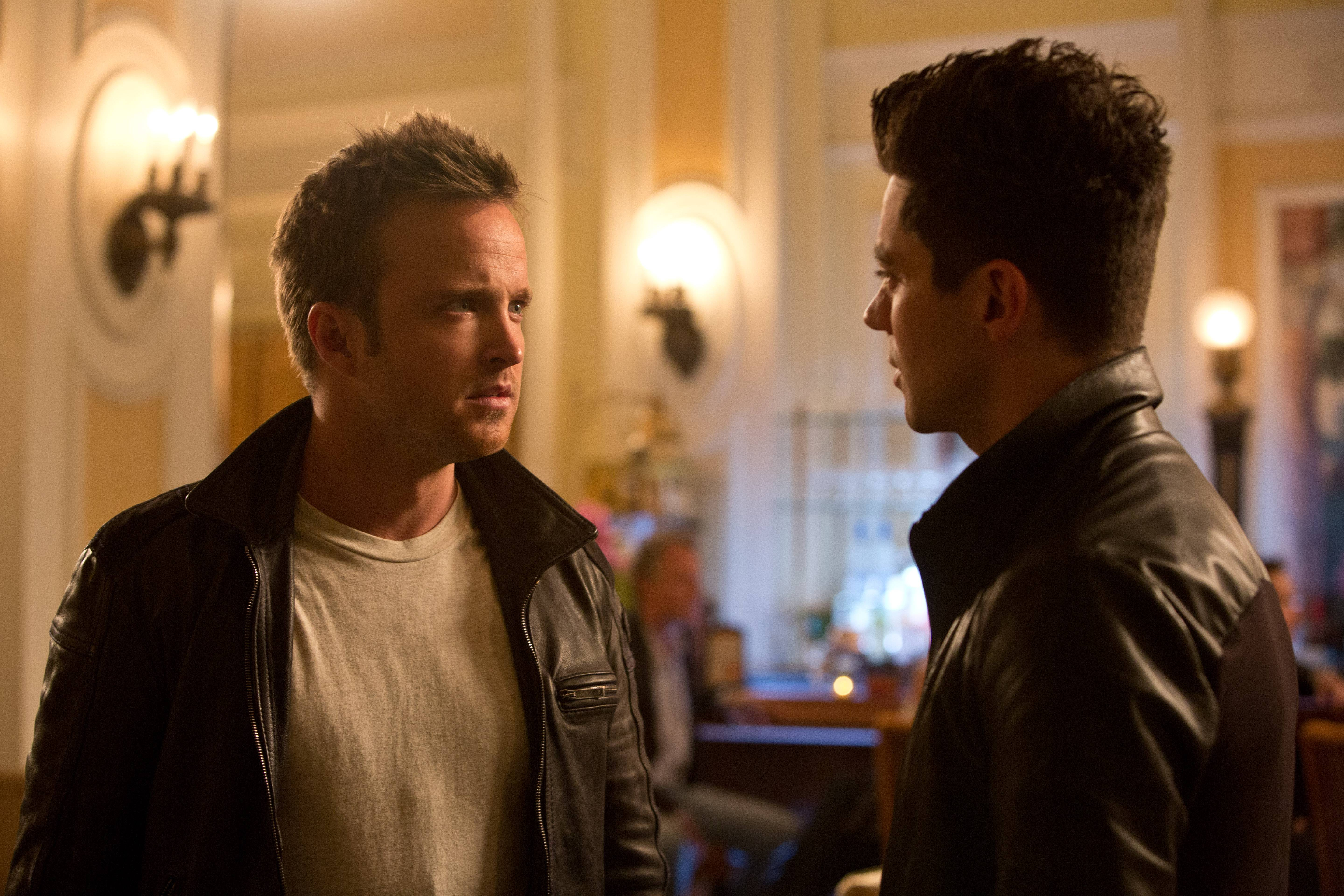 "Tobey Marshall (Aaron Paul) confronts Dino Brewster (Dominic Cooper) in ""Need for Speed."""