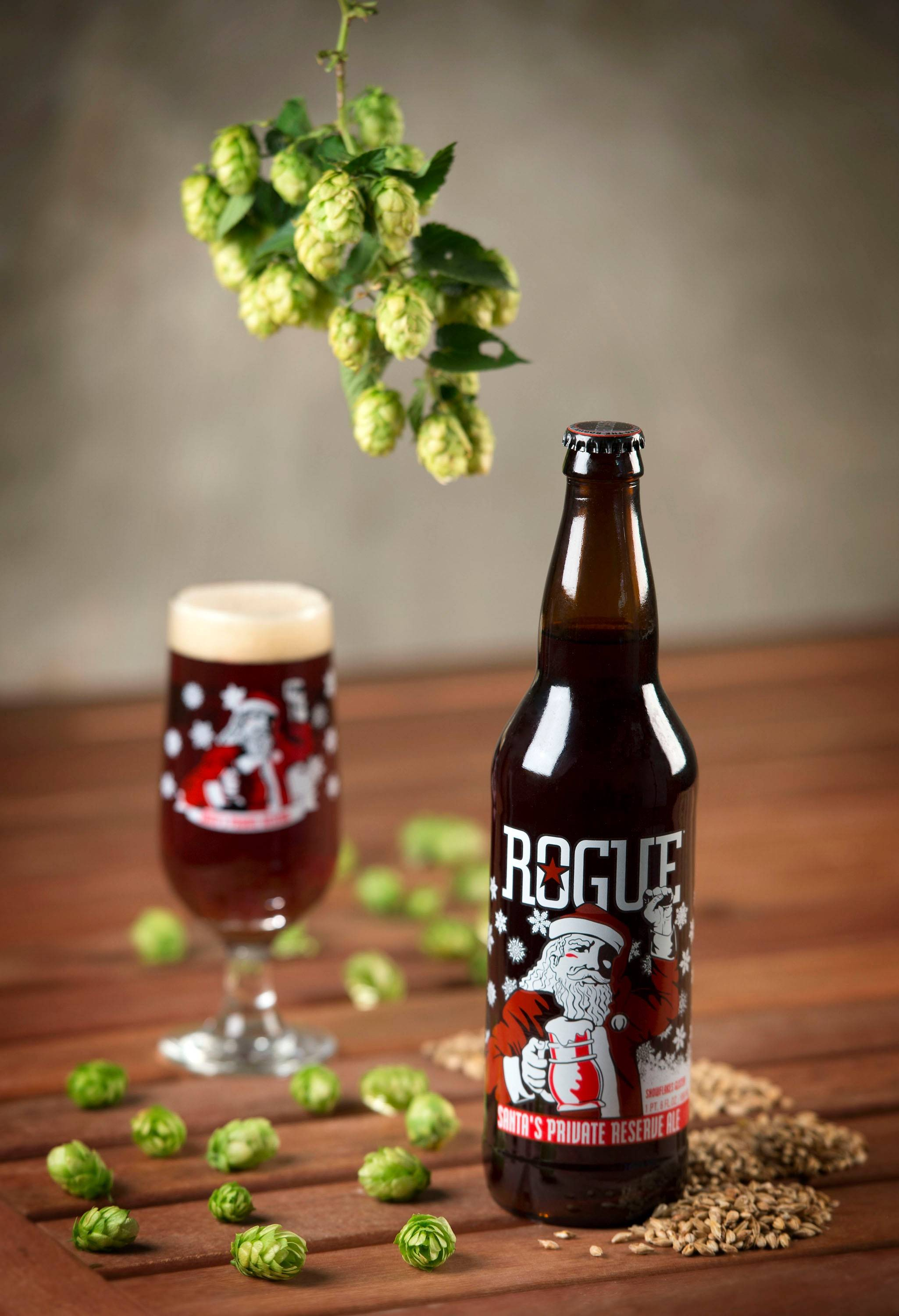 This product image released by Rogue Ales of Newport, Ore., shows a bottle of the company's Santa's Private Reserve. Rogue Aleís annual holiday offering is a double-hopped red ale made with hops and barley from the breweryís own farm. The brewery and distillery founded in 1988 even malted the grain in the beer themselves. The result is a two-time World Beer Championship gold medal-winning amber beer with a roasted caramel malt flavor and a hoppy pine finish.