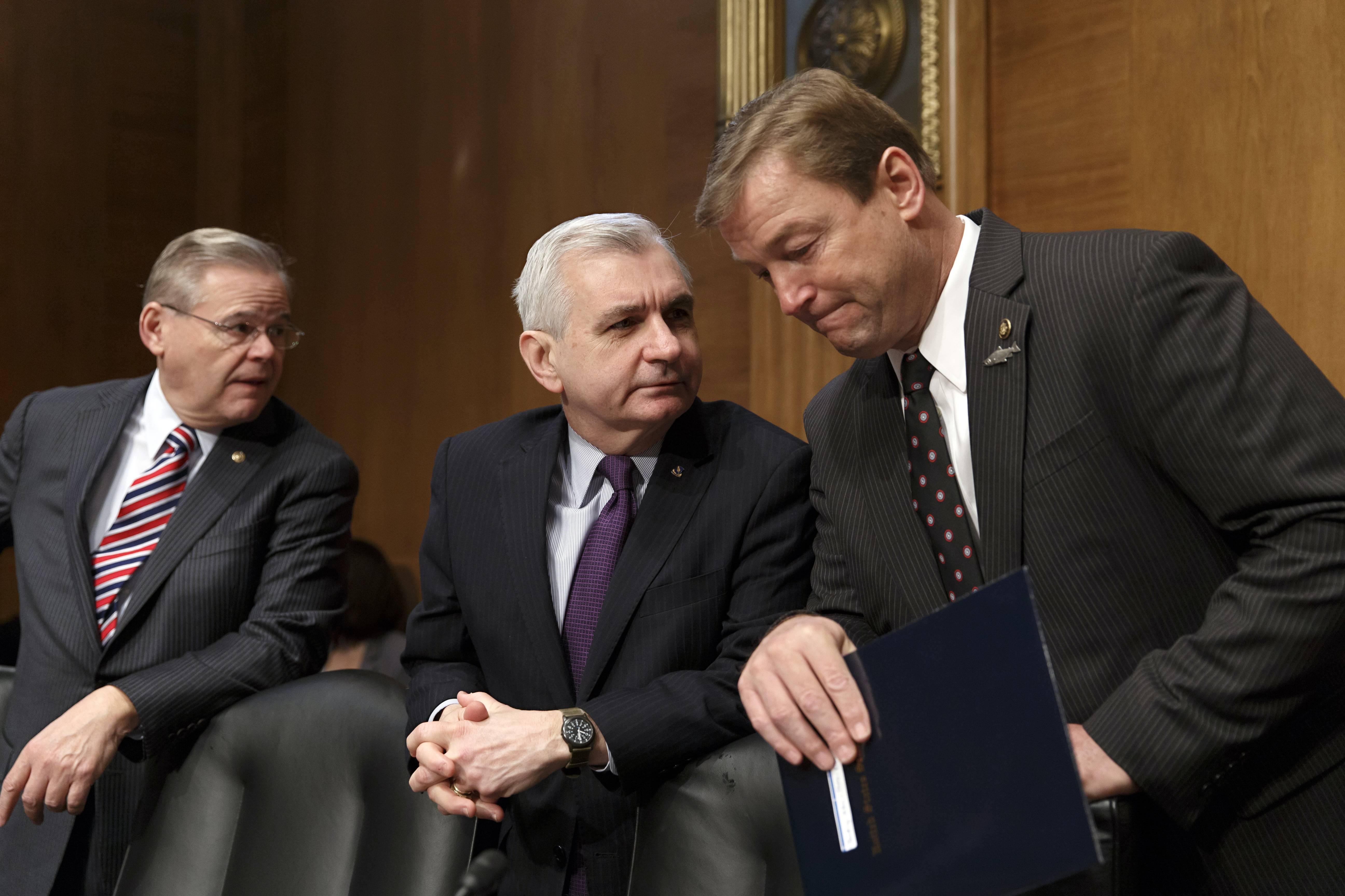 "Sen. Jack Reed of Rhoden Island, center, confers with Sens. Dean Heller of Nevada, right, and Robert Menendez of New Jersey on Capital Hill on Feb. 27. Reed, a leading bargainer in talks over extending unemployment benefits, said Thursday's Senate agreement would ""provide a little certainty to families, business and the markets that Congress is capable of coming together to do the right thing."""