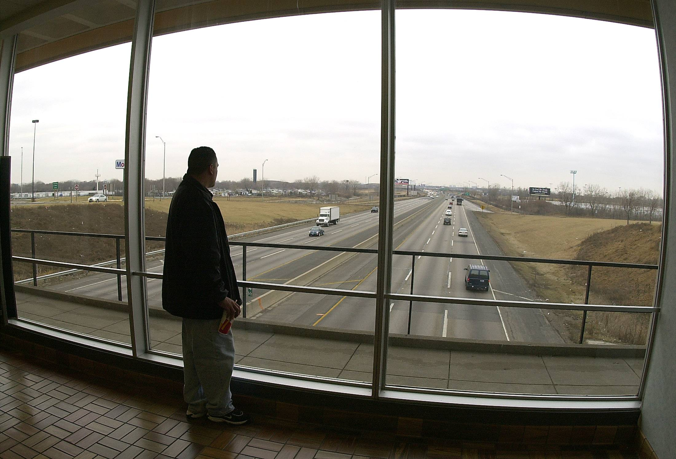 Looking like a big movie screen to the world of transportation, Greg Carranza of Elgin waits to take his wife to O'Hare who works at United Airlines.