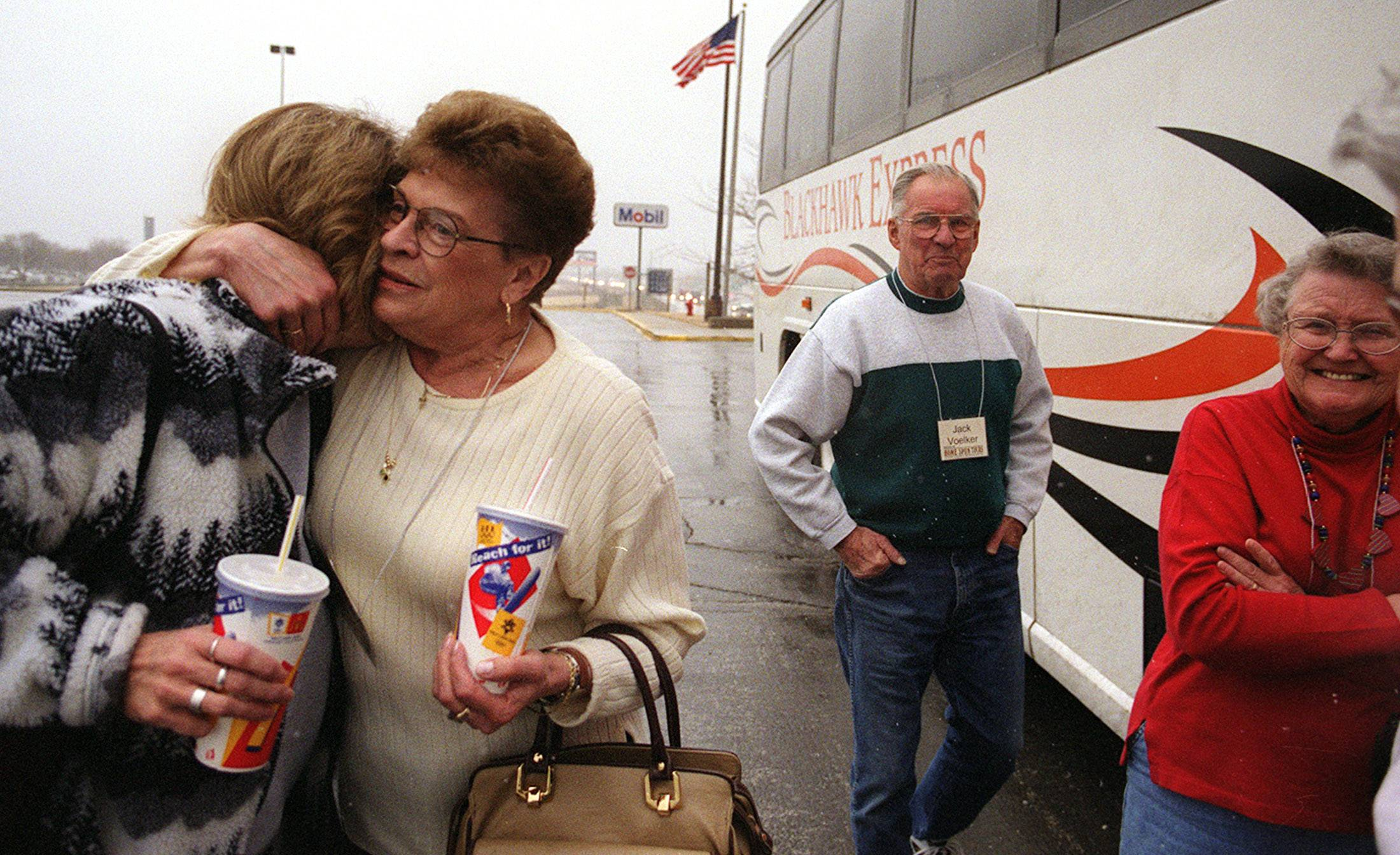 Ann Vujica, left, of Berwyn hugs her mother Lydia Svoboda of Rice Lake, Wi. Ann's mother was on a tour bus which briefly stopped at the oasis before journeying toward the East Coast.