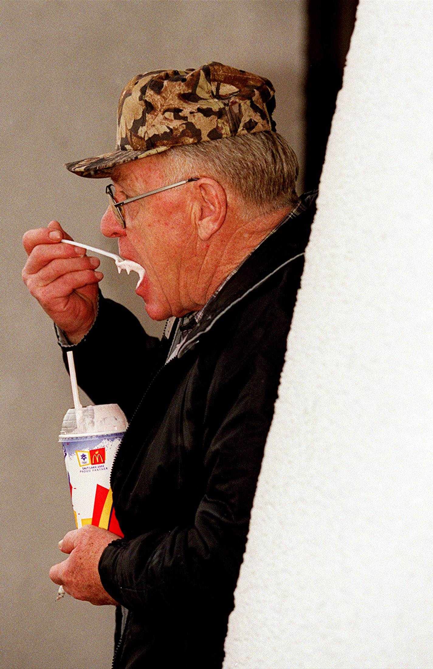 Rich Yunk of Park Falls, Wis. enjoys a smoke and a bite of ice cream at the Des Plaines Oasis.