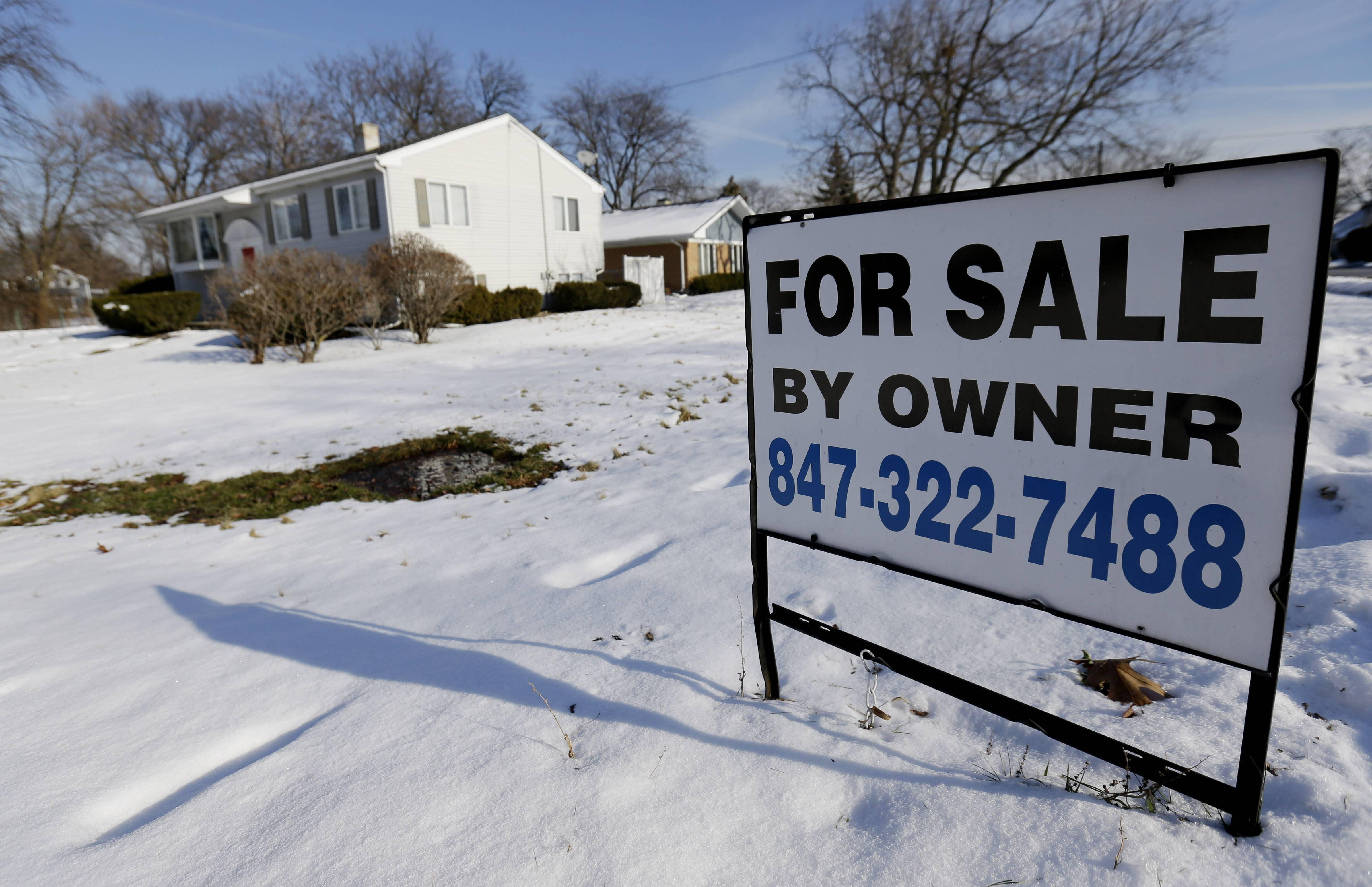 A home is for sale in Glenview. Average U.S. rates on fixed mortgages rose last week but remained close to historically low levels.