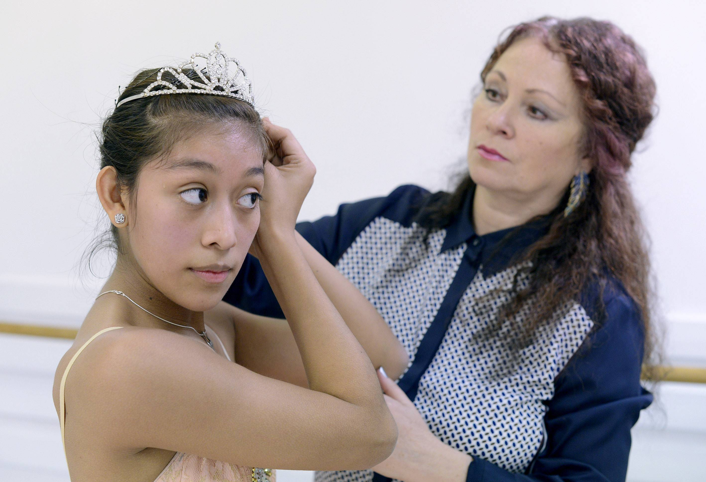 Dancer Jasmine Getz of Sleepy Hollow, a student at Hampshire High School, puts on her tiara after changing into her tutu during class with instructor Tatyana Mazur at the Faubourg School of Ballet in Hanover Park.