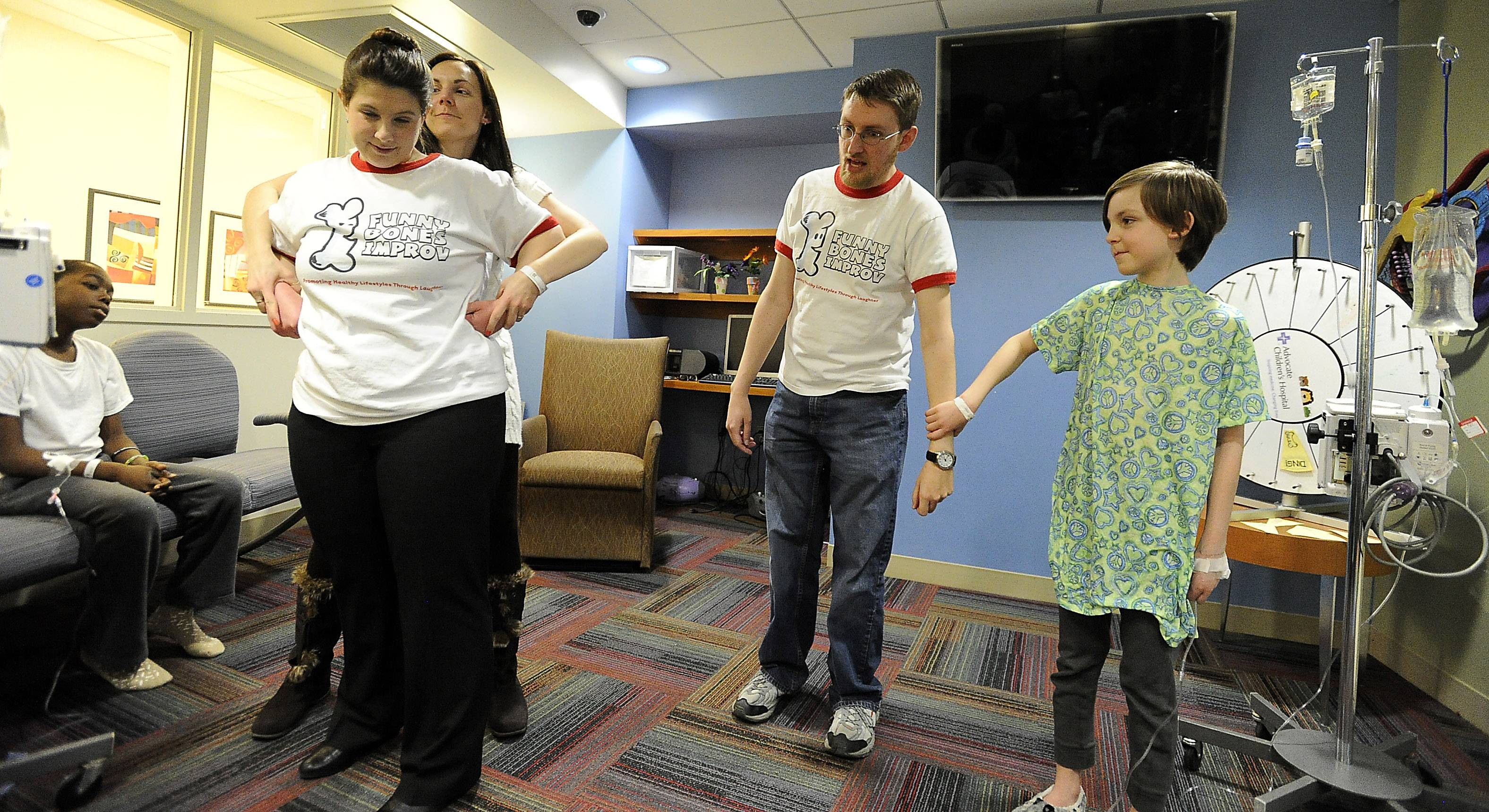 Feeling well enough to become part of the show, Luke Wickman, 9, and his mom, Carolina, work with Funny Bones Improv actors Stuart Allard of Downers Grove and Debbie Schreiner of Mount Prospect.