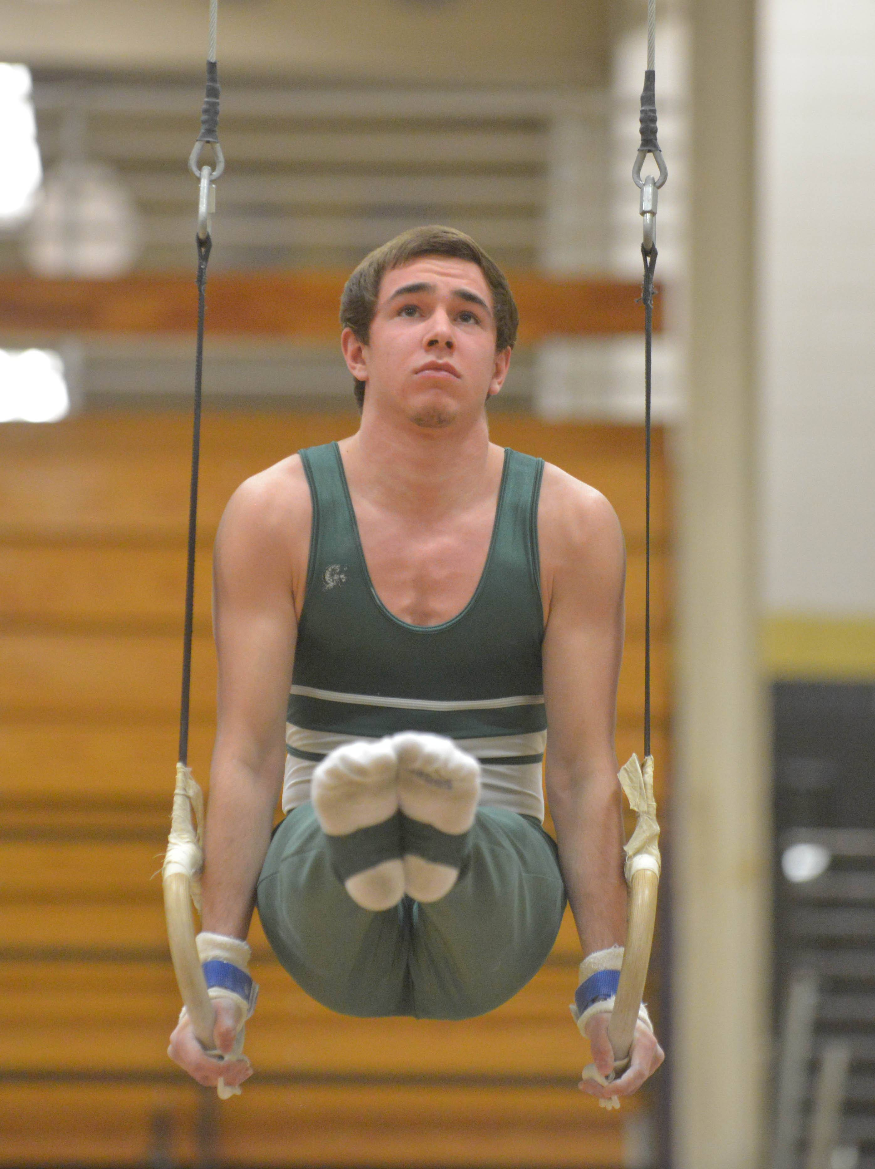 Tommy Berland of Glenbard West on the rings during the District 87 boys gymnastics meet Thursday at Glenbard North High School.