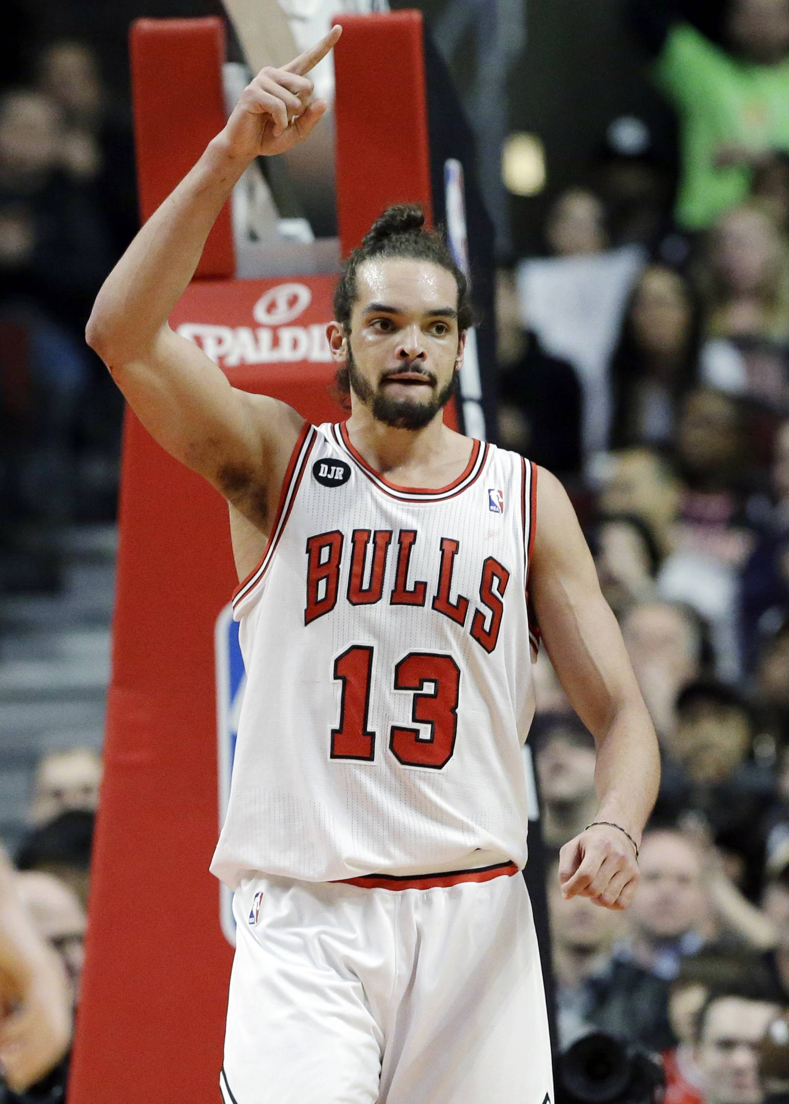 Chicago Bulls center Joakim Noah celebrates after scoring a basket during the first half of an NBA basketball game against the Houston Rockets in Chicago on Thursday, March 13, 2014.