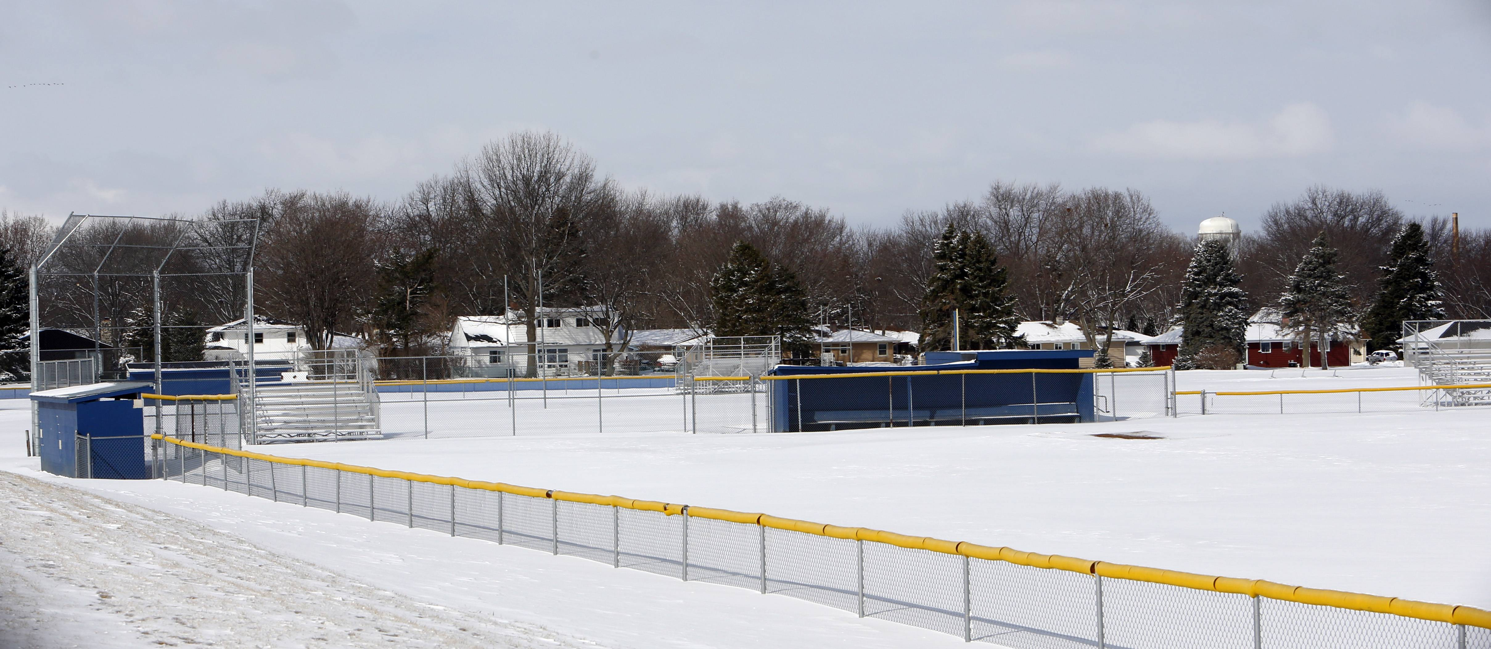 The Larkin High School baseball diamond remains under a cover of snow Wednesday.
