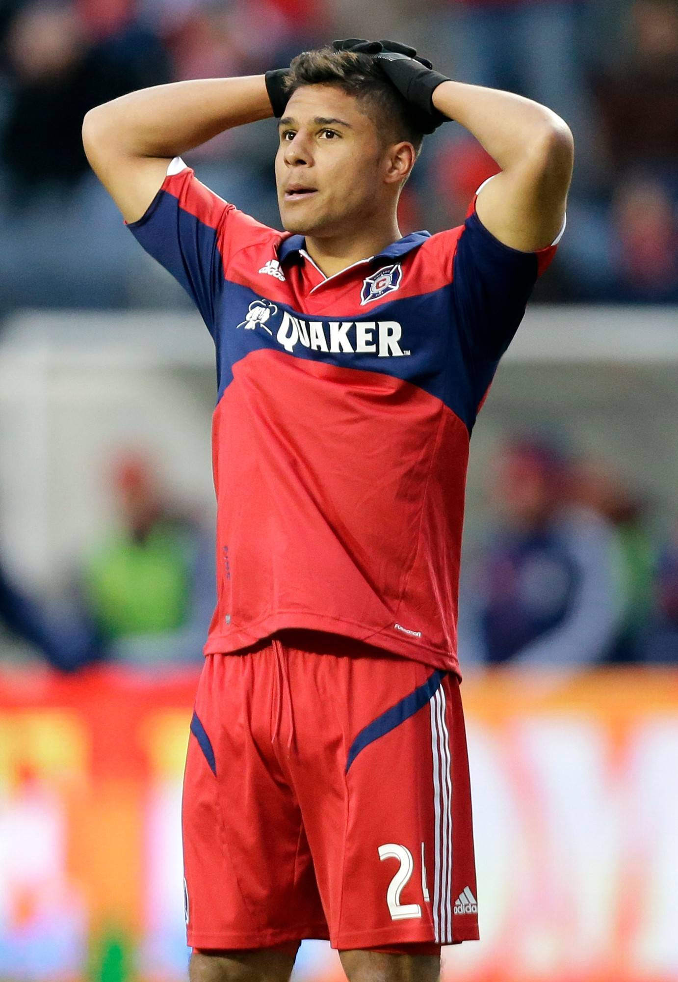 Chicago Fire forward Quincy Amarikwa reacts as he checks the scoreboard during the second half of an MLS match against Chivas USA at Toyota Park in Bridgeview last March. The Fire lost 4-1.