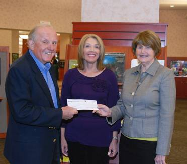 (from left) John Zulaski, Science Kits for Public Libraries project director, presents a grant check to Schaumburg Township District Library Executive Director Stephanie Sarnoff and Youth Services Director Melissa Jones.Susan Miura