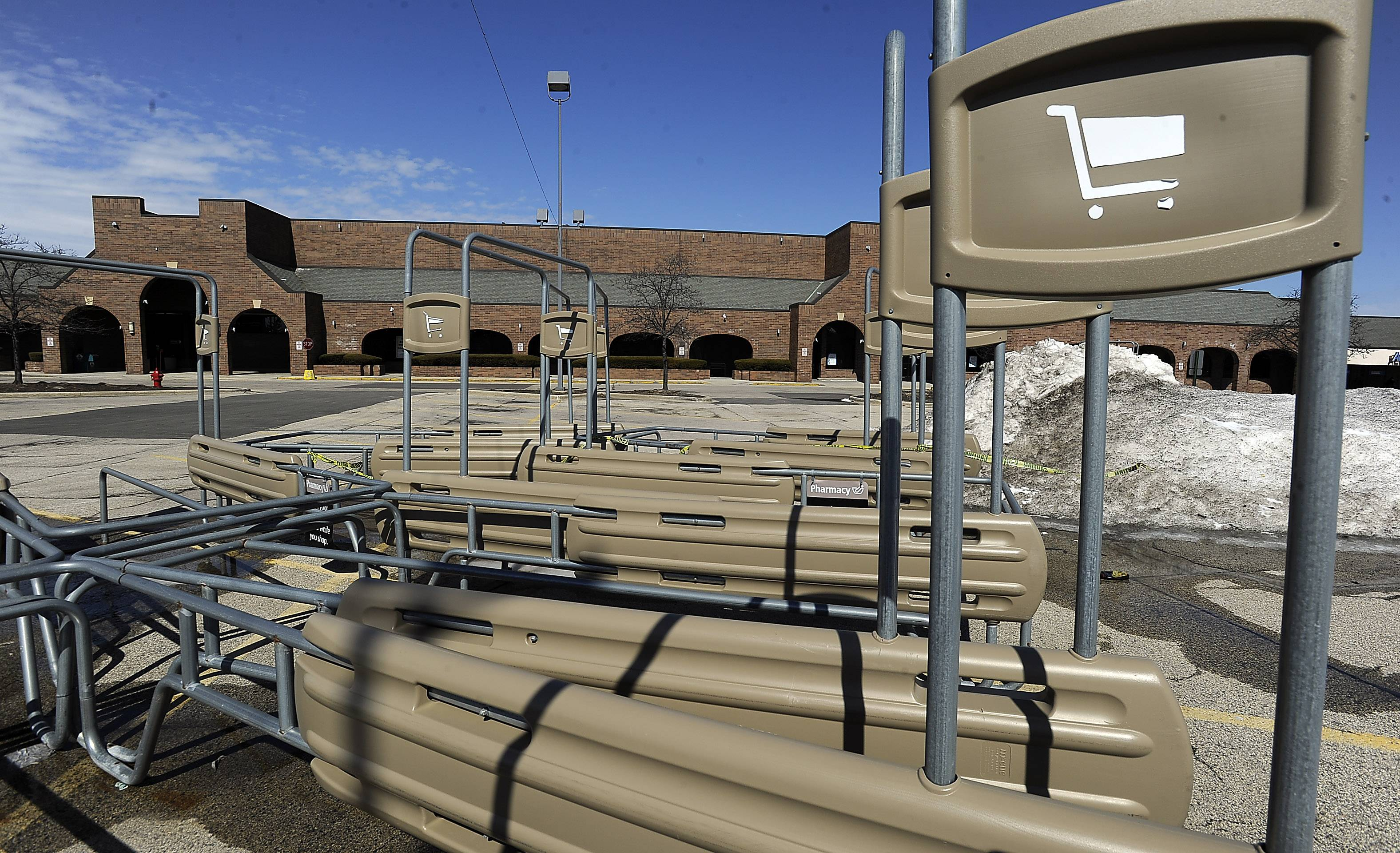 Empty shopping cart holders sit in the former Dominick's parking lot in Buffalo Grove's Chase Plaza on Lake-Cook Road. An unconfirmed report suggested that Elgin-based Butera Market will be converting it into a Piggly Wiggly.