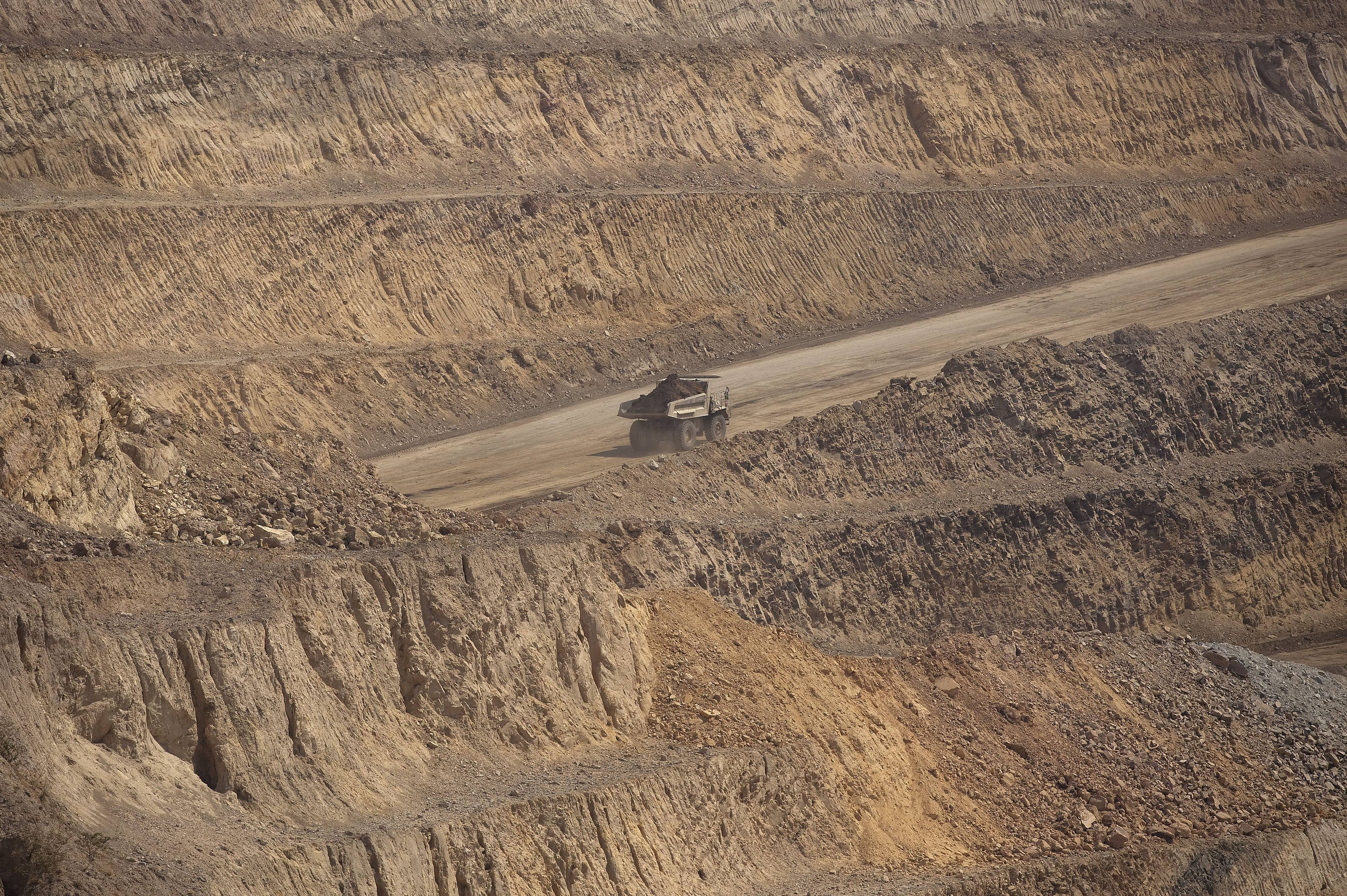 Ore is driven to a processing plant earlier this week in a Caterpillar Inc. mining truck after being excavated from an open pit at Katanga Mining Ltd.'s KOV copper and cobalt mine in Kolwezi, Katanga province, Democratic Republic of Congo.
