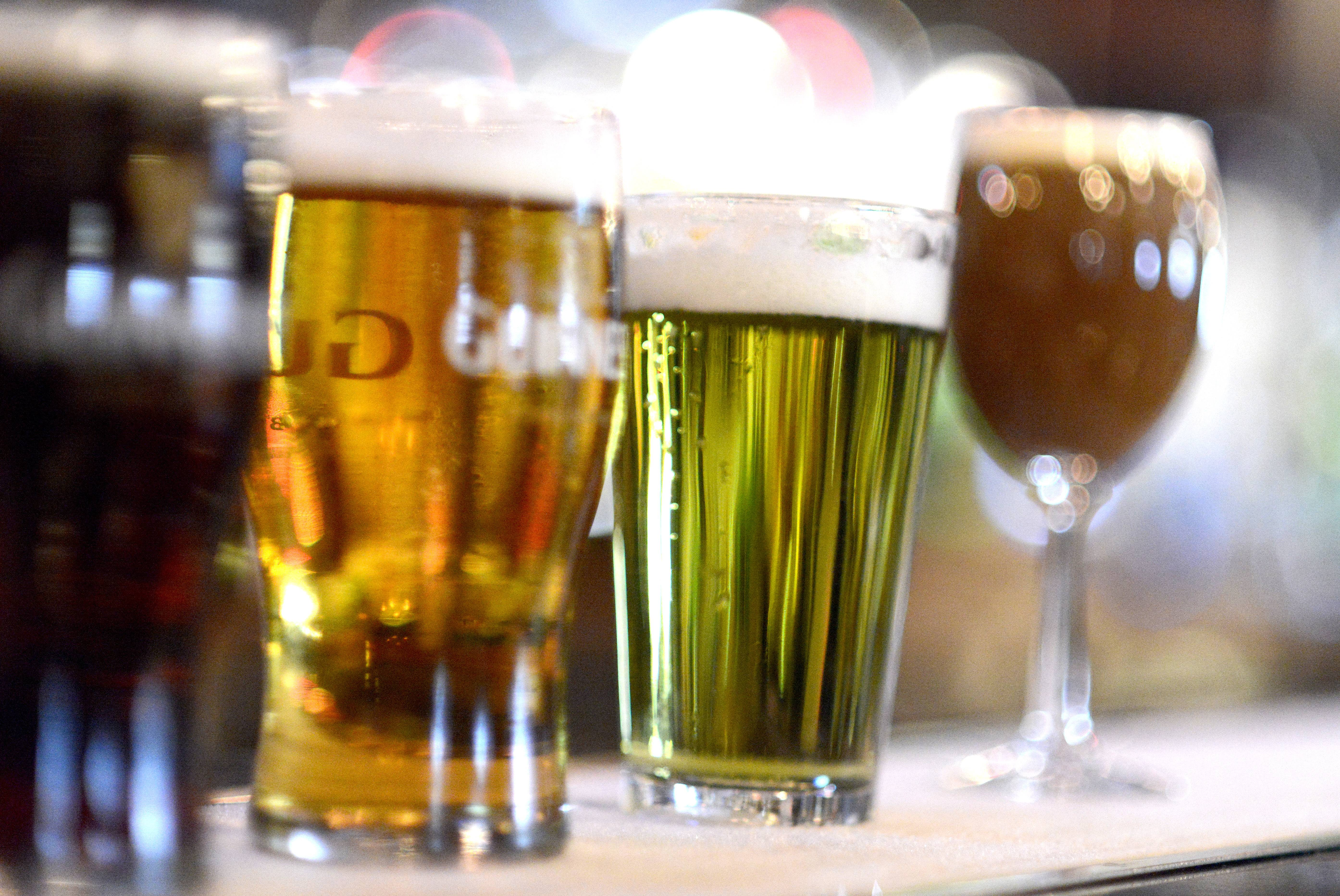 A variety of well-known Irish beers, including one dyed green, are available at Claddagh Irish Pub in Geneva.