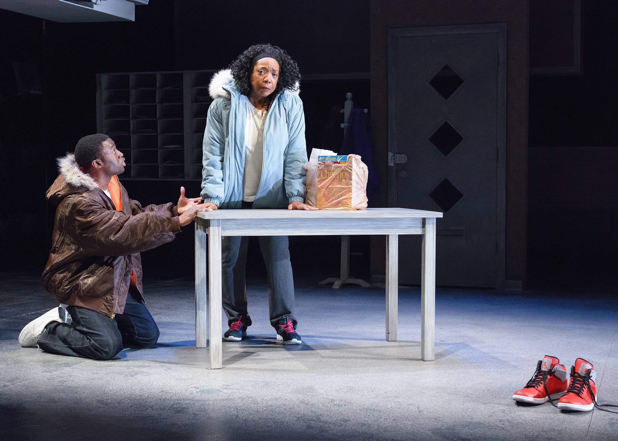 "Noel (Tosin Morohunfola), left, a struggling young man and new father, confesses to his mother (Jacqueline Williams) about what he's done in a moment of desperation in Marcus Gardley's ""The Gospel of Lovingkindness,"" in its world premiere at Victory Gardens Theater."
