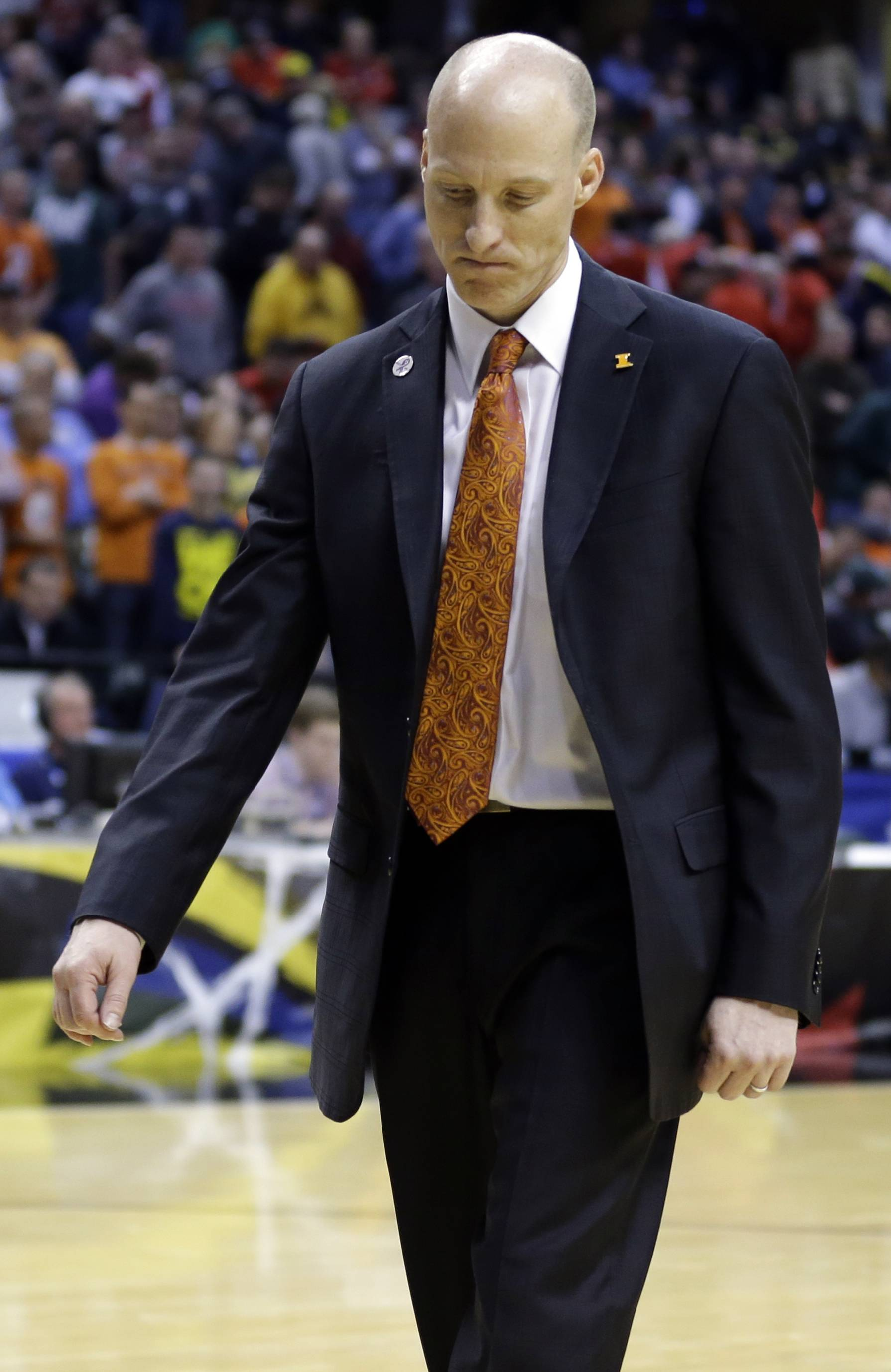 Illinois head coach John Groce walks off the court Friday after losing to Michigan in the quarterfinals of the Big Ten Conference tournament in Indianapolis.