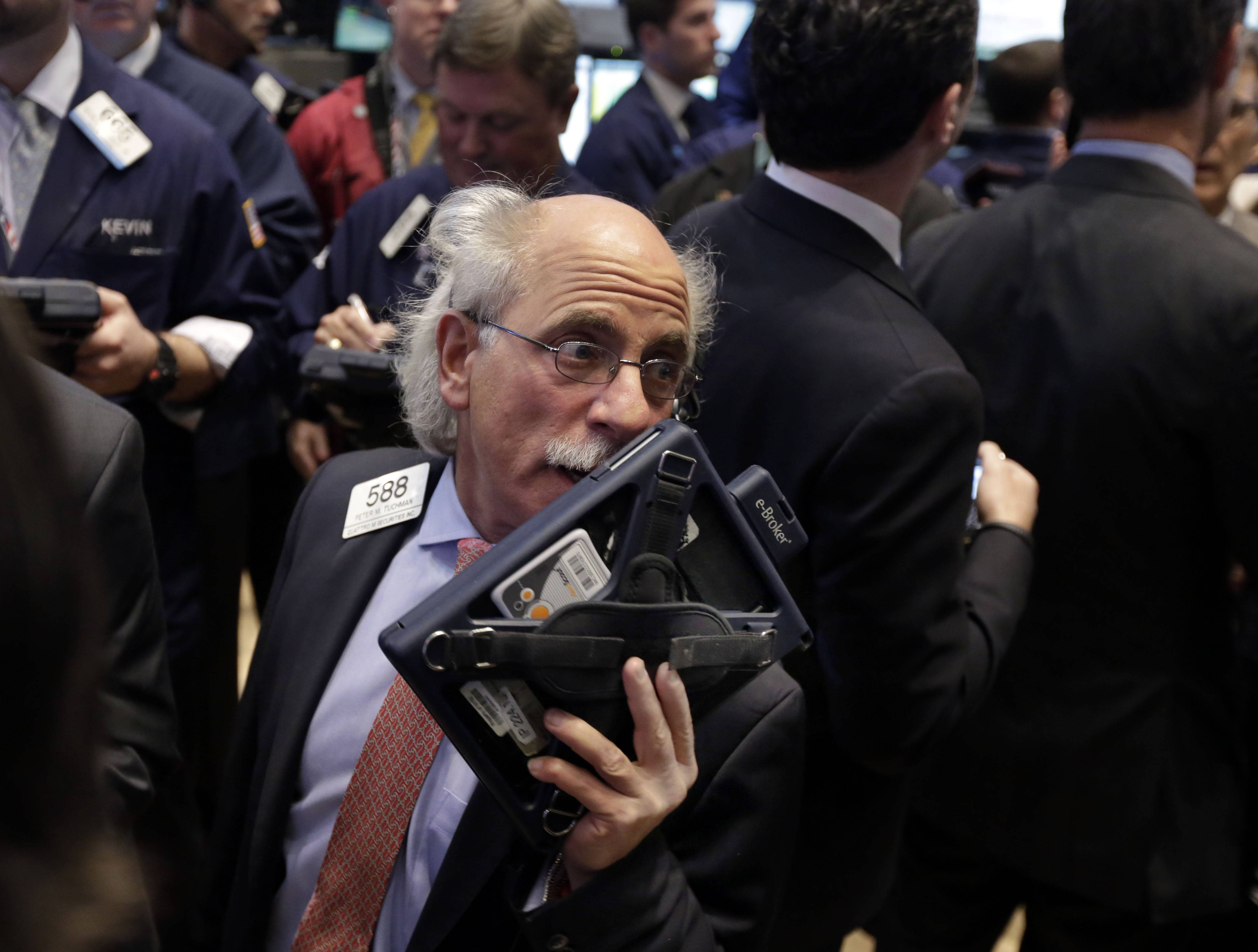 Trader Peter Tuchman works Friday on the floor of the New York Stock Exchange.