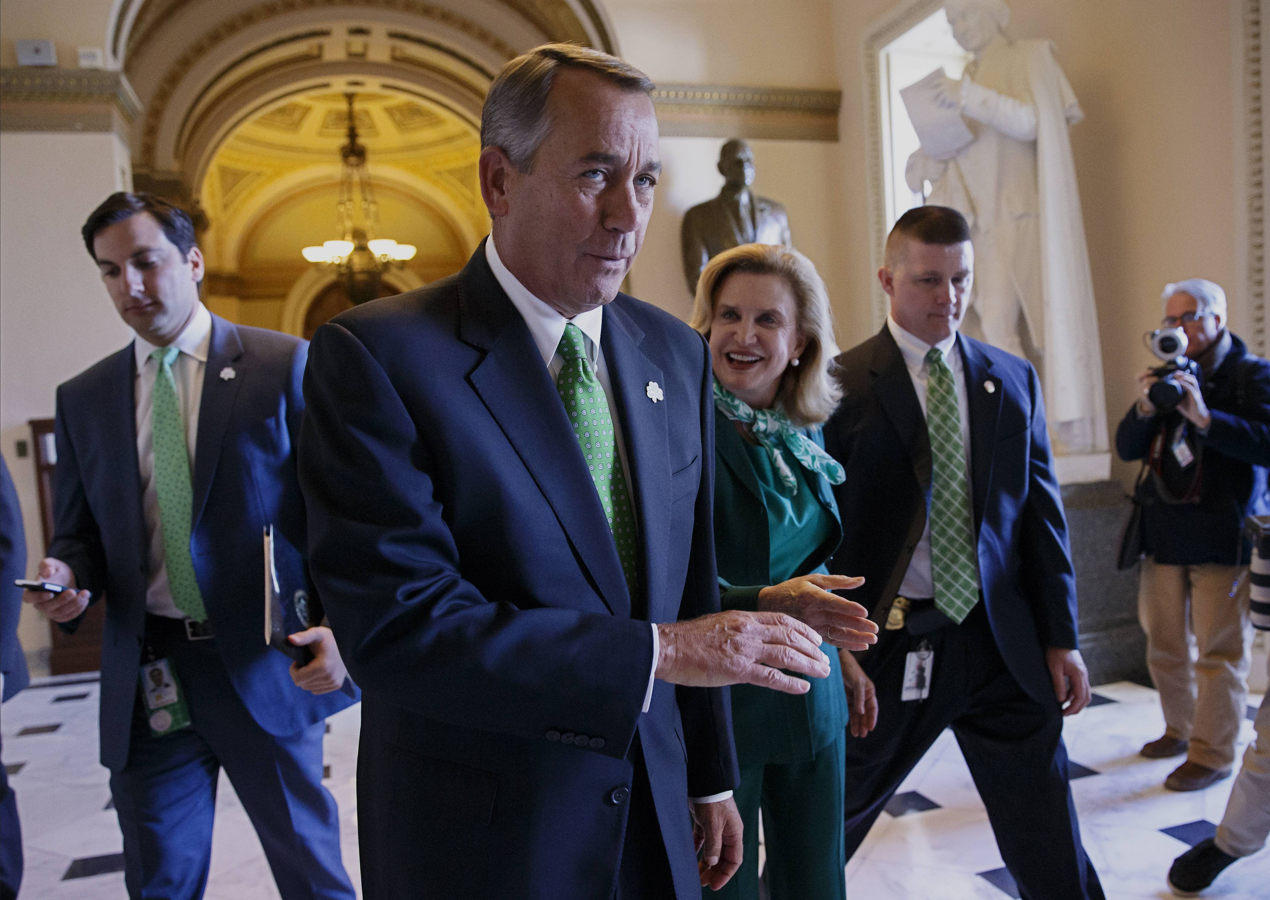 After being greeted by Rep. Carolyn Maloney, a New York Democrat, center right, House Speaker John Boehner of Ohio leaves the House chamber Friday on Capitol Hill in Washington, where the Republican-controlled House voted for the 51st time in 26 months to neuter the nation's health care law.